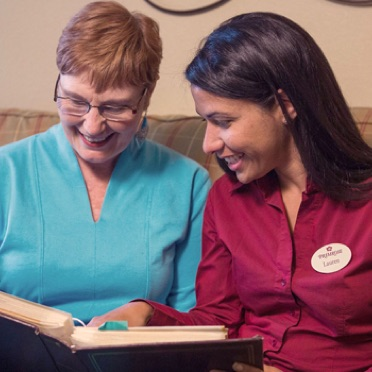 primrose worker reading with resident