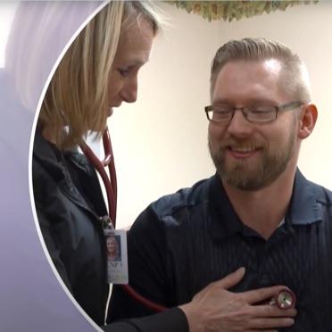 healthcare worker listening to patients heart