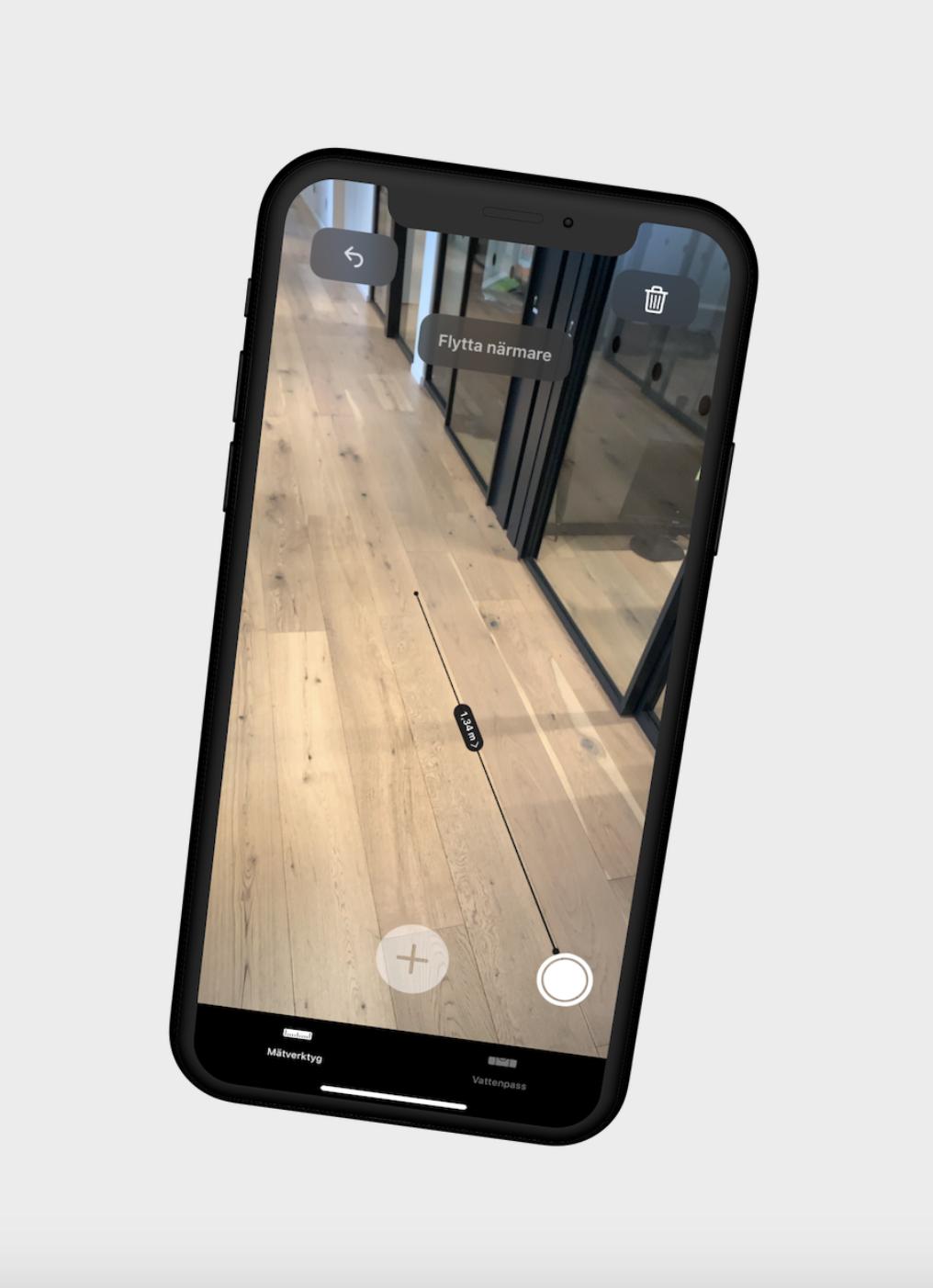 Done visar hur du mäter ditt golv i mobil