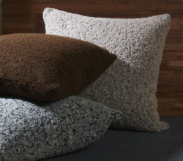Three large soft pillows lined with gray and brown.