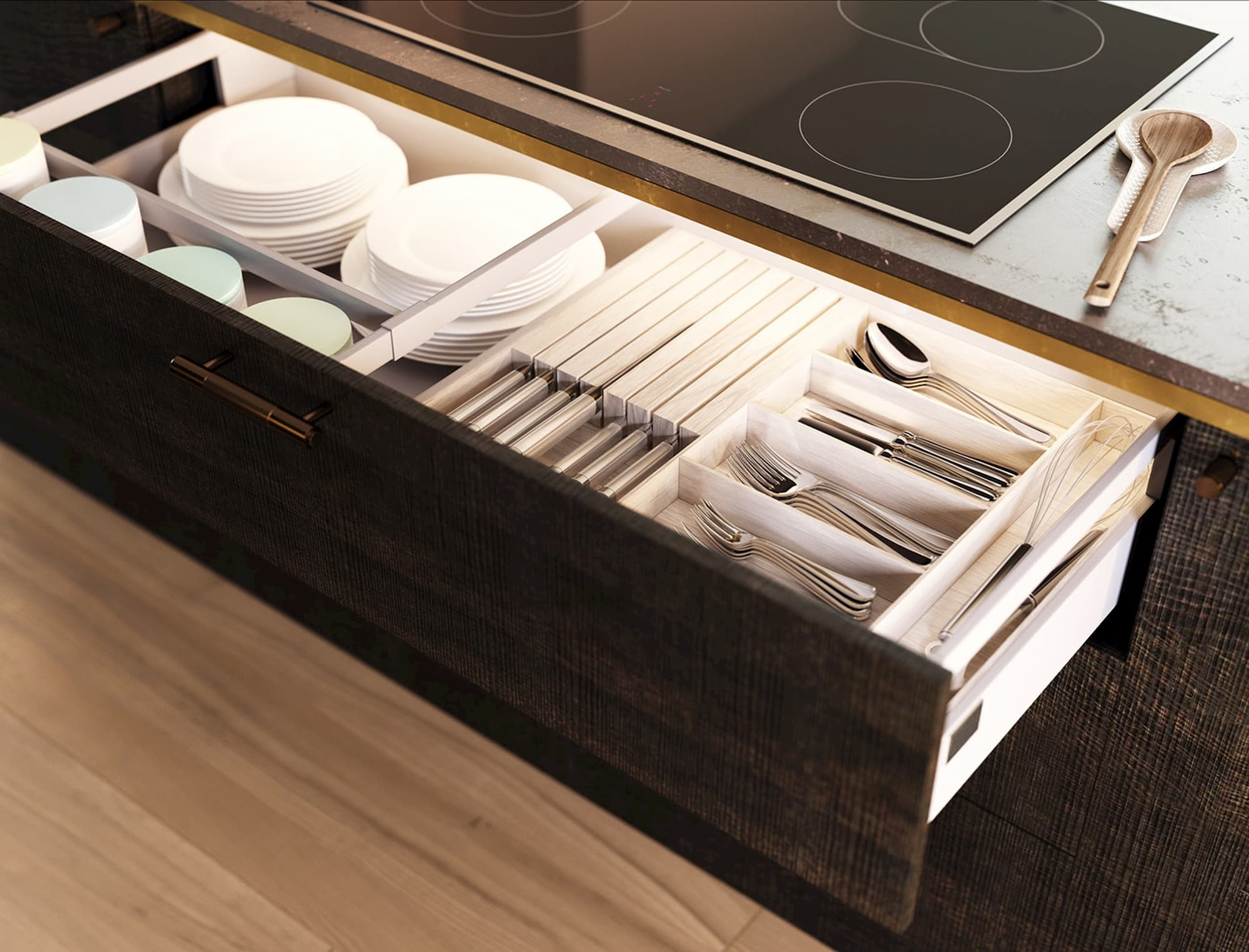 Kitchen drawer divided into neat compartments for plates and silverware