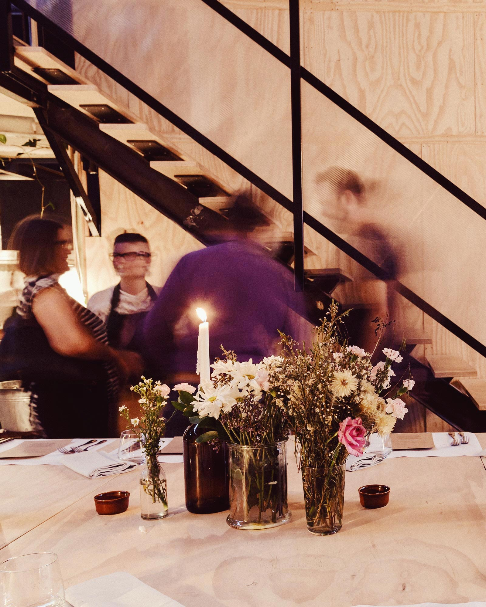 Picture of people standing in front of stairs at supper club function at Colab 4010