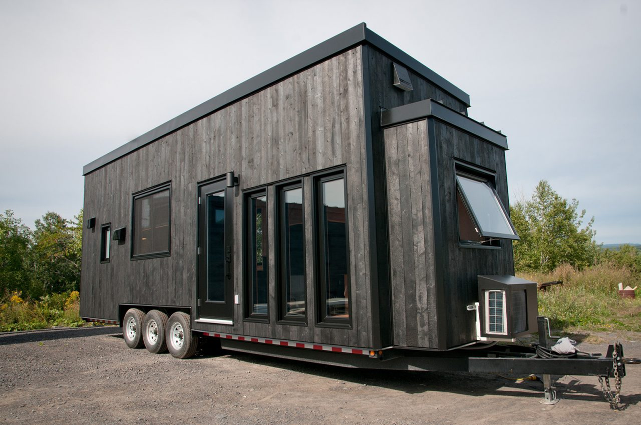 A true minimalist tiny home design. Not because it lacks but because all things unnecessary or unlovely have been removed. The Orme shows off clean and simplistic building materials like Shou Sugi Ban exterior siding, smooth maple plywood interior walls, and expansive black windows.