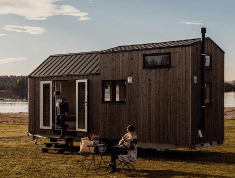 Small tiny house on wheels near lake