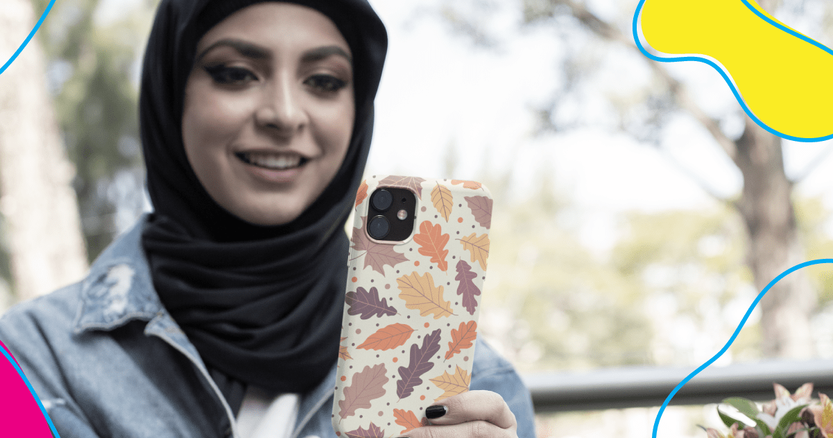 Woman using a phone with a print-on-demand phone case.