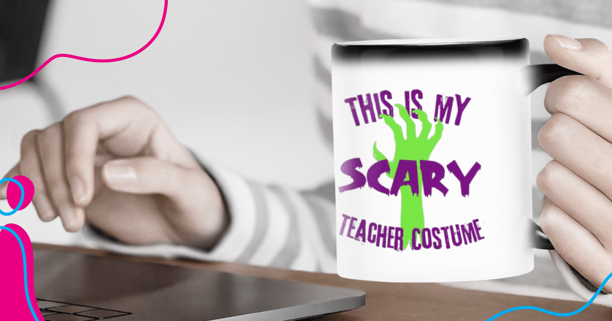 Color changing print-on-demand mug with Halloween inspired design in front of a man with a laptop.