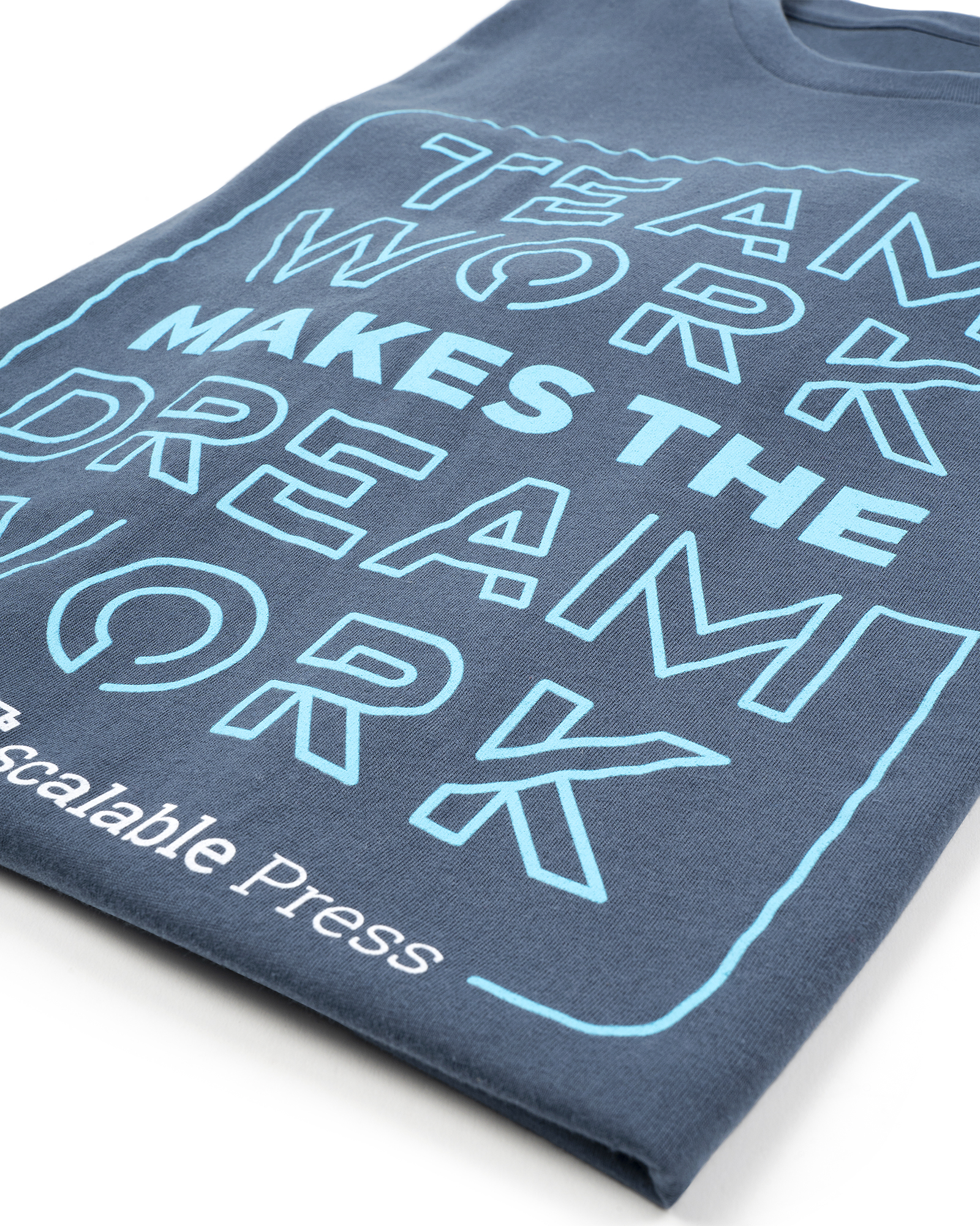 Fuel print of the Scalable Press logo on a dark blue shirt