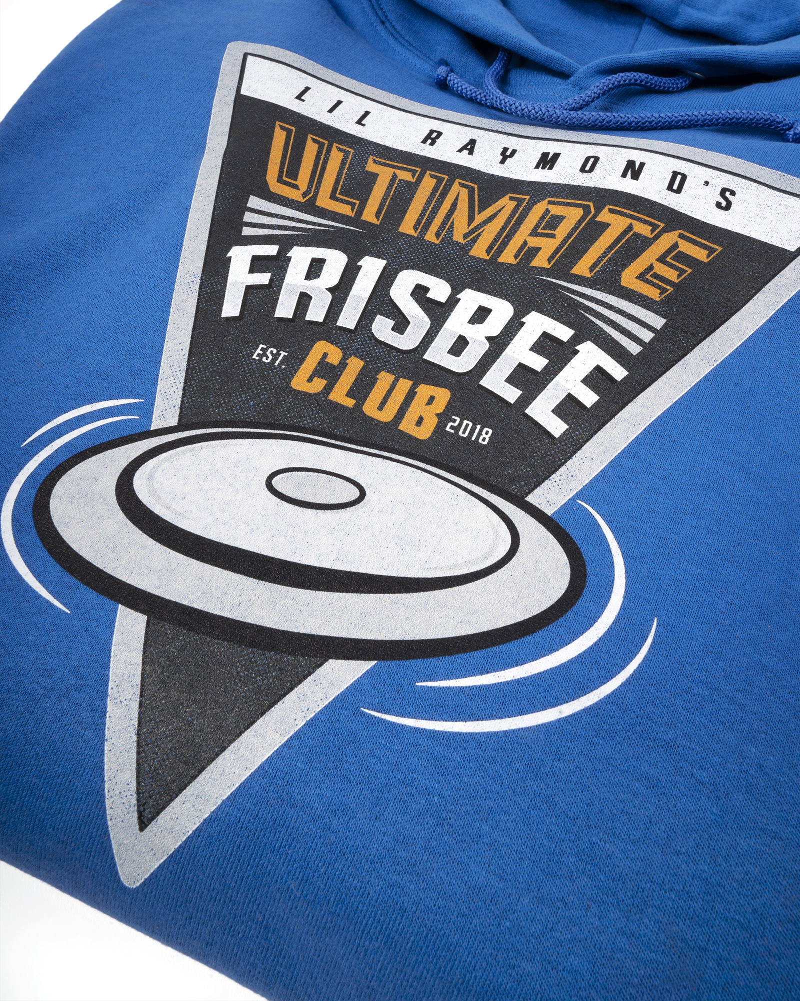 A closeup of the Fuel print of a Frisbee Club logo on a folded blue hoodie