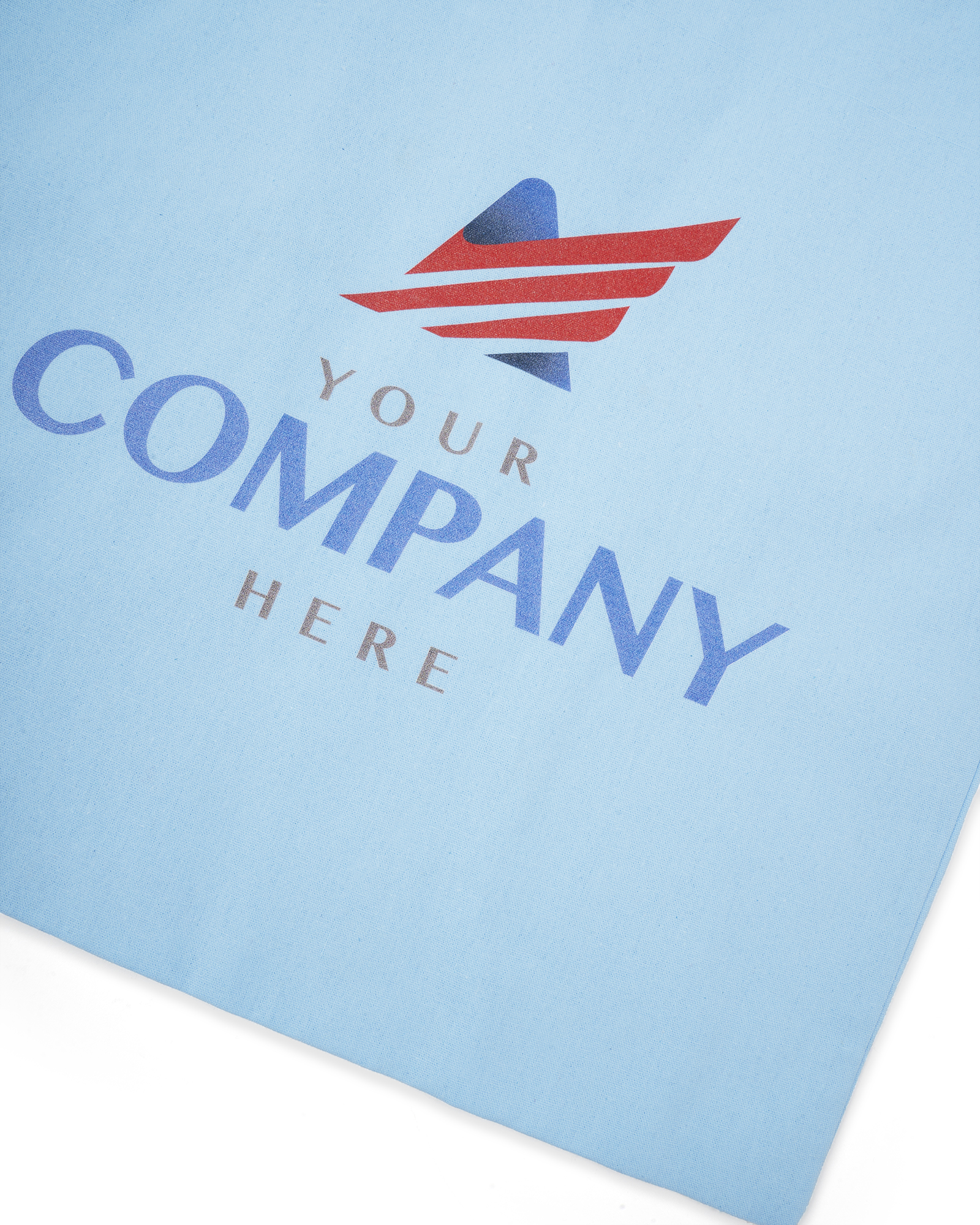 A close up of the Fuel print of a generic company logo on a light blue canvas tote