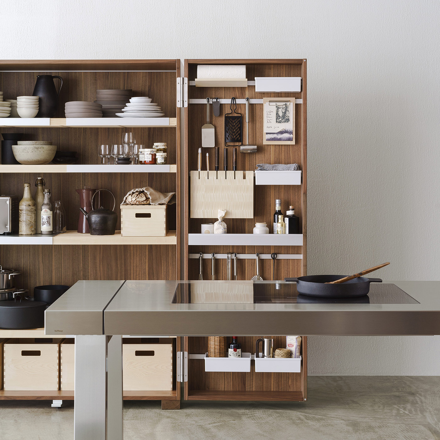 open b2 kitchen tool cabinet with pots, pans, utensils, knives, tableware, glassware and food storage