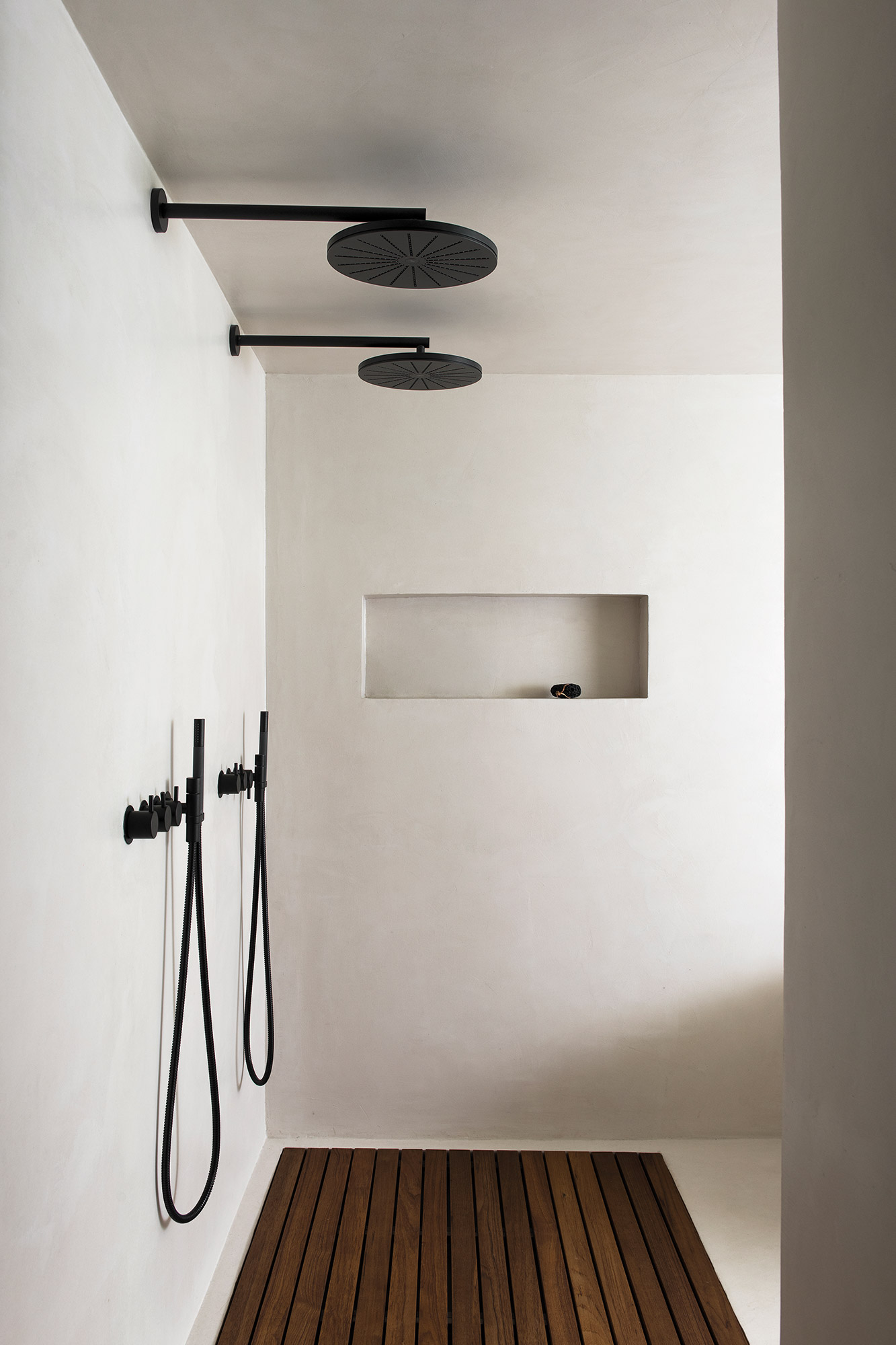 Black shower fixtures by Vola