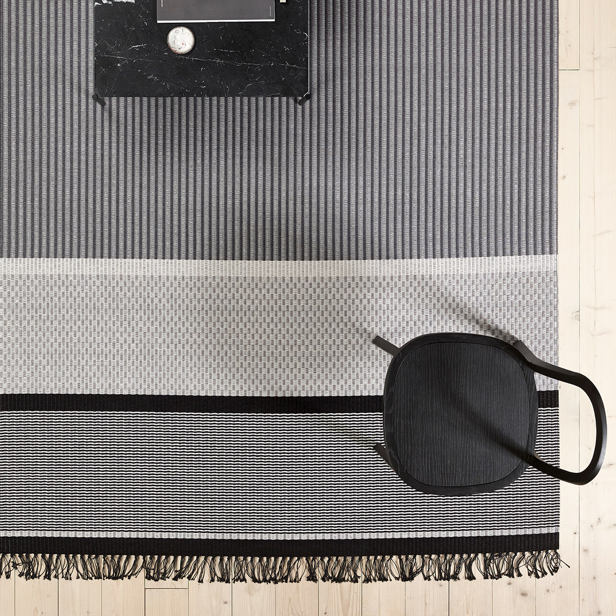 San Francisco carpet with black chair by Woodnotes