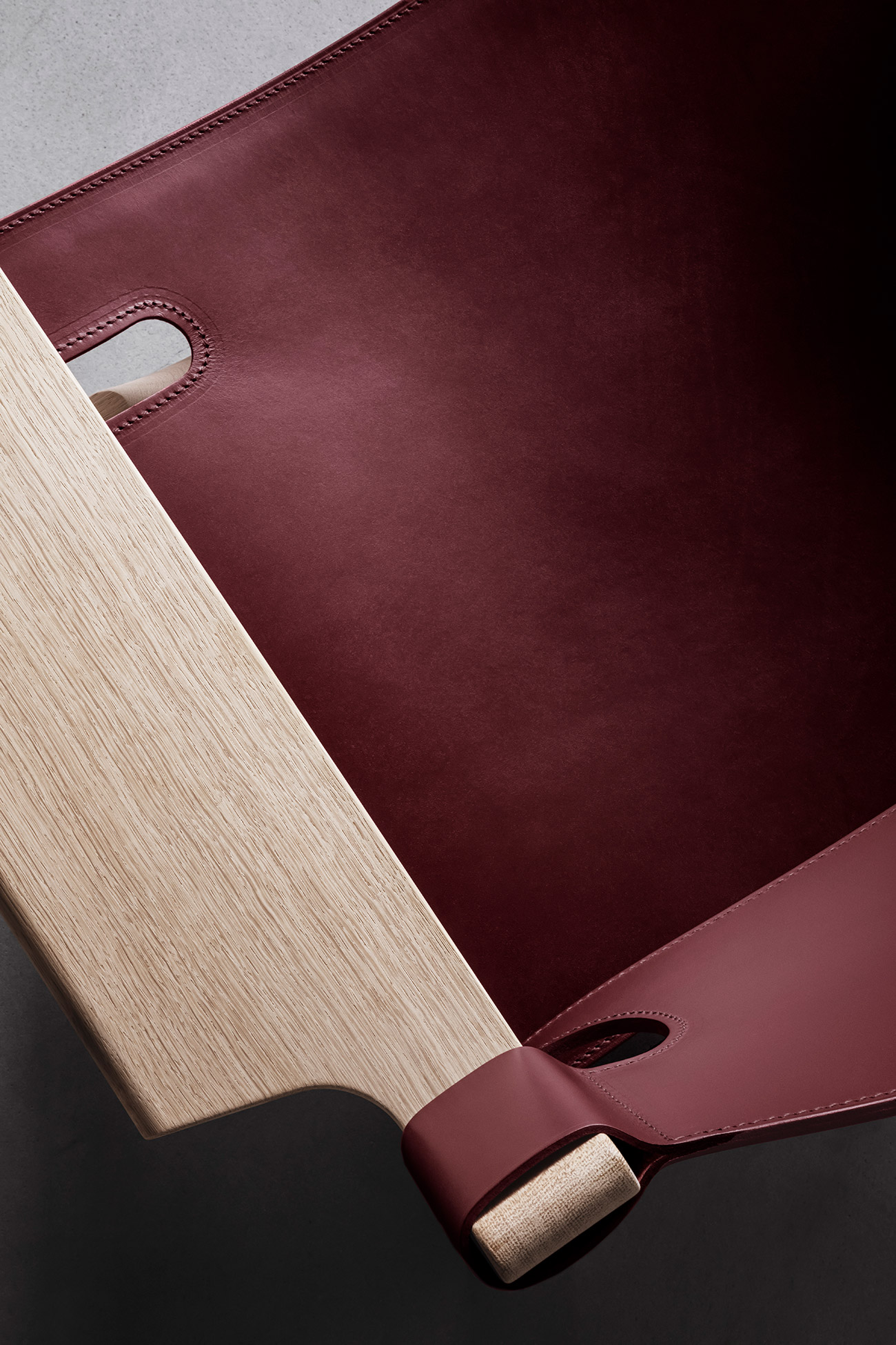 Detail of Spanish Chair in deep red by Fredericia