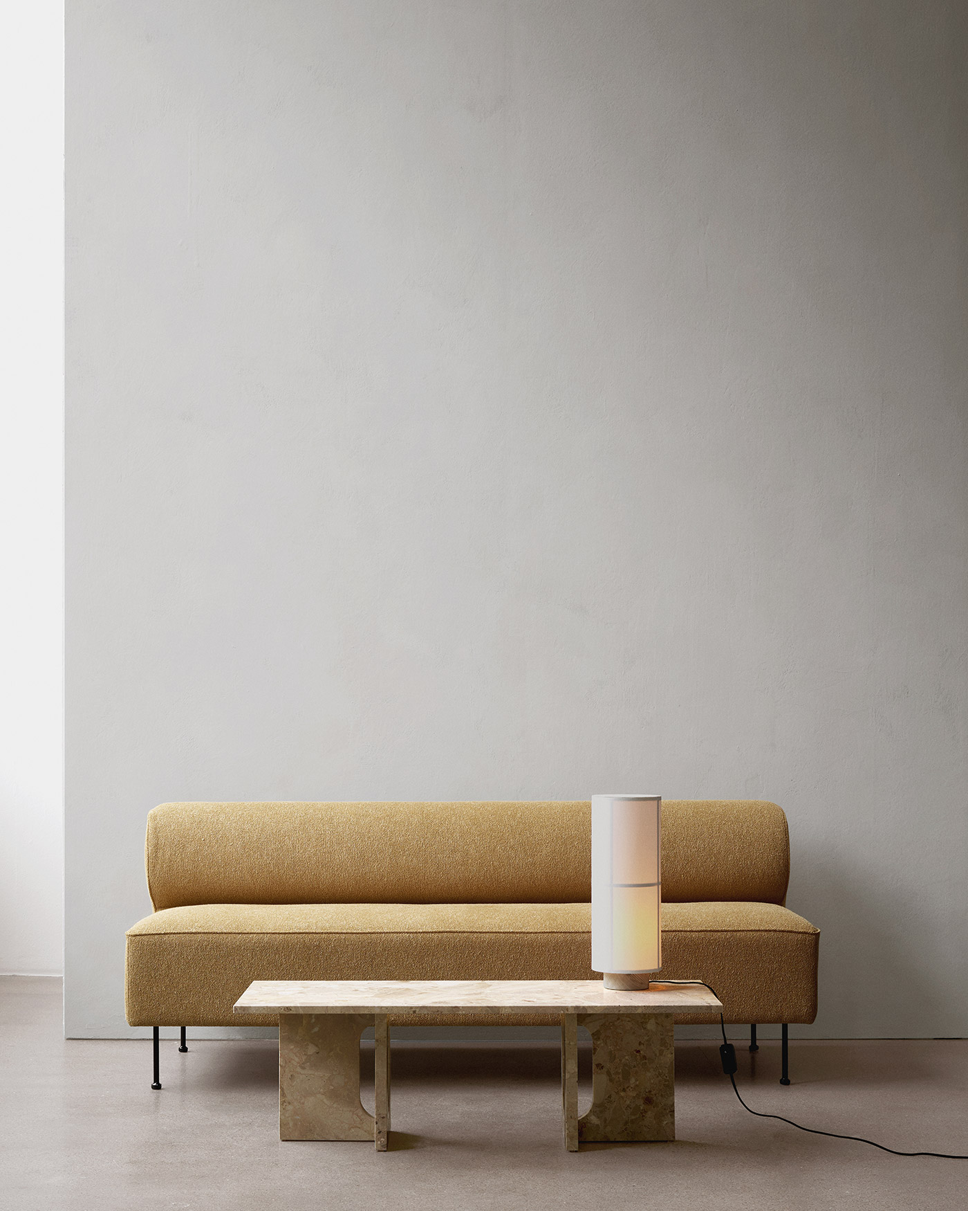 Modern minimal sofa against grey wall