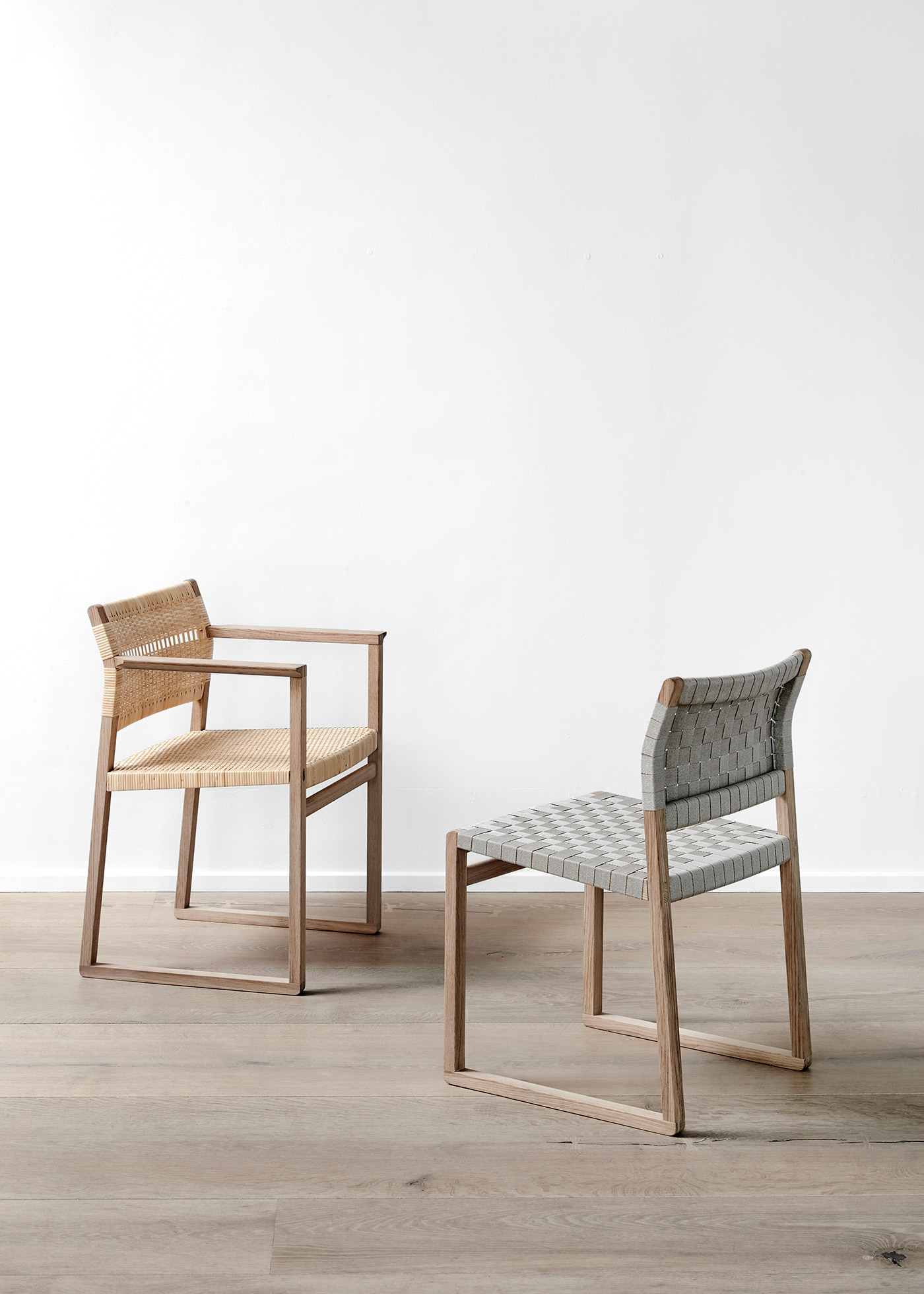 BM61 and BM62 chairs by Fredericia against white wall