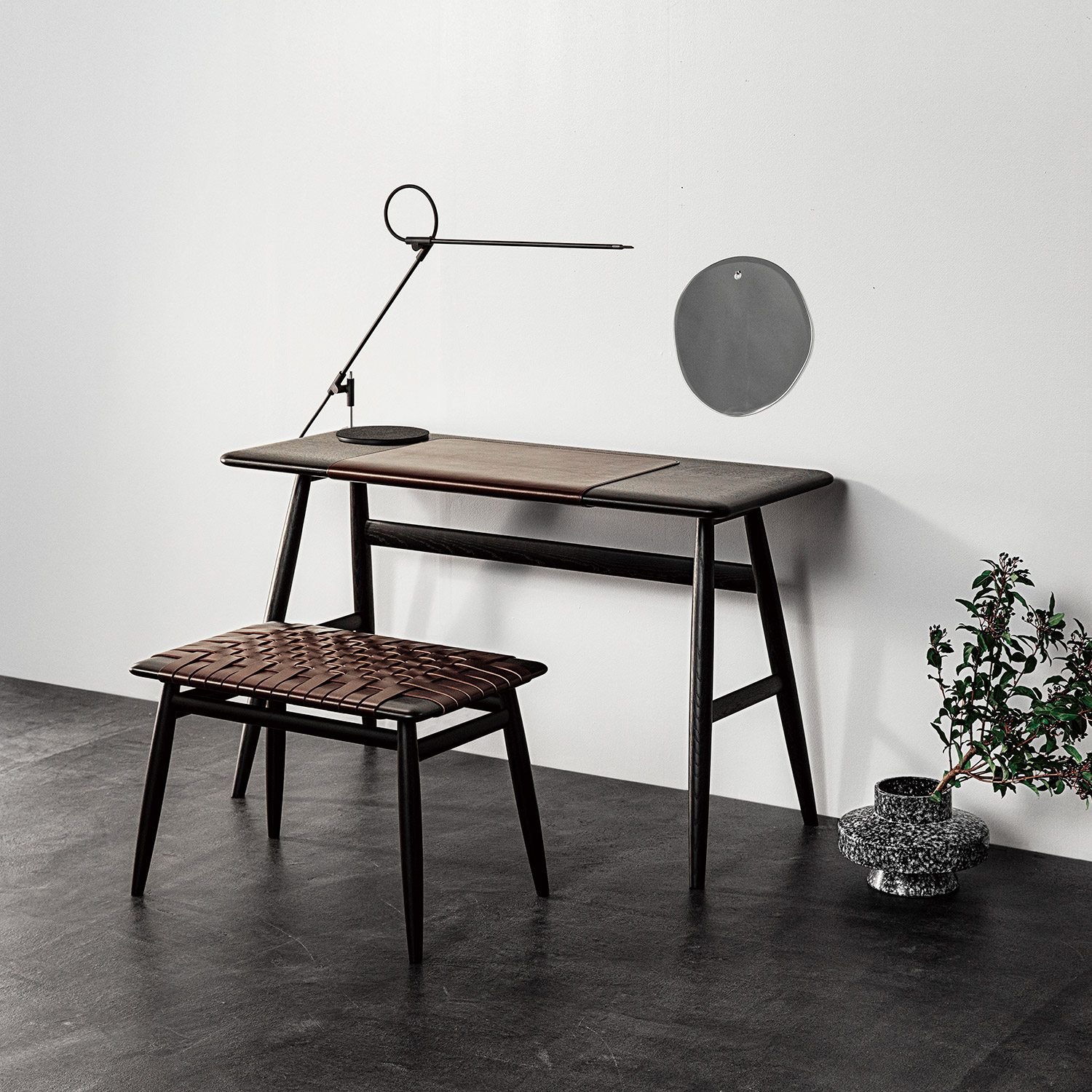 Modern minimal black wooden desk and stool, concrete floor