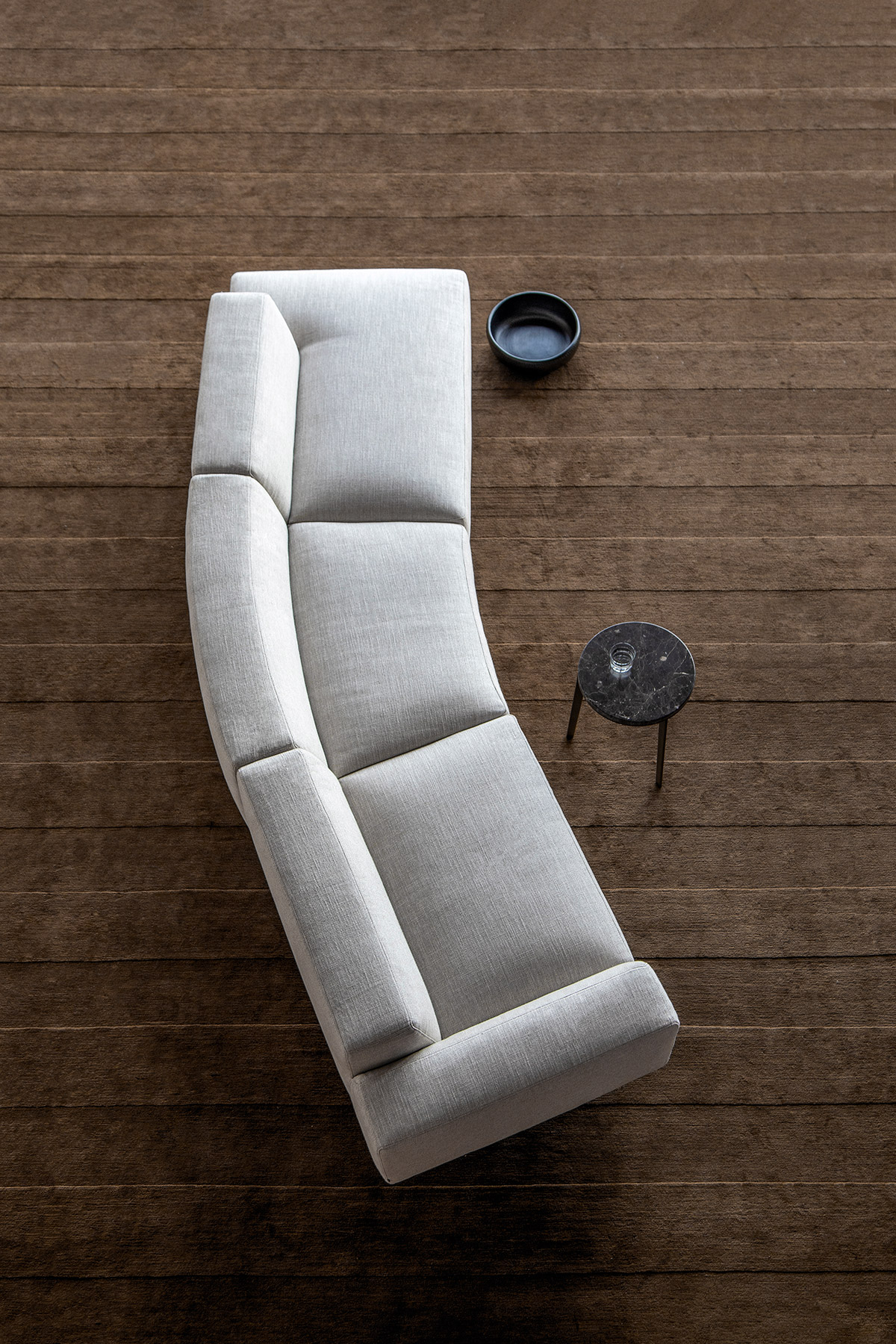 Endless sofa by Bensen in grey fabric on brown carpet