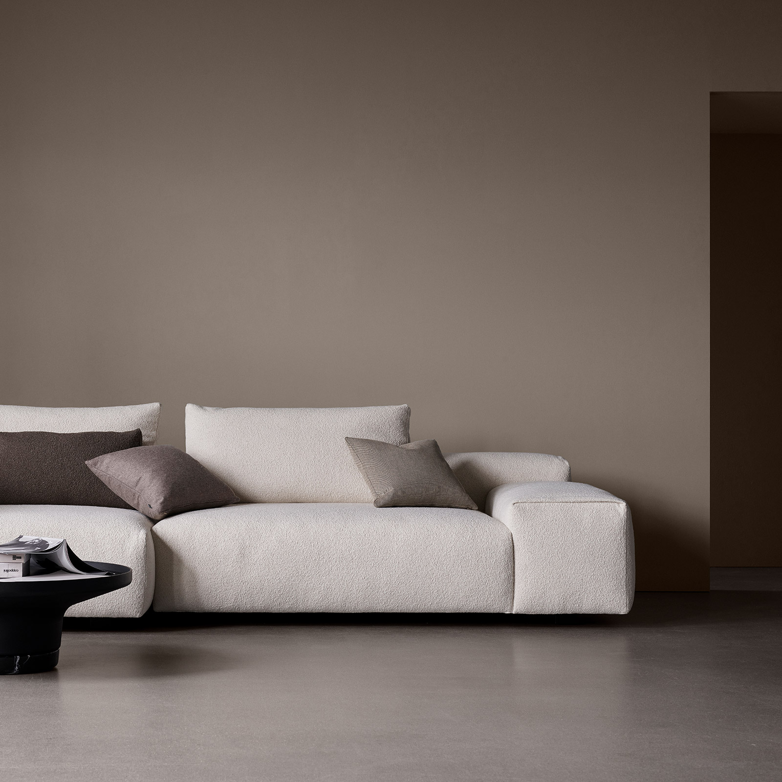 Raft sofa by Wendelbo in cream bouclé fabric