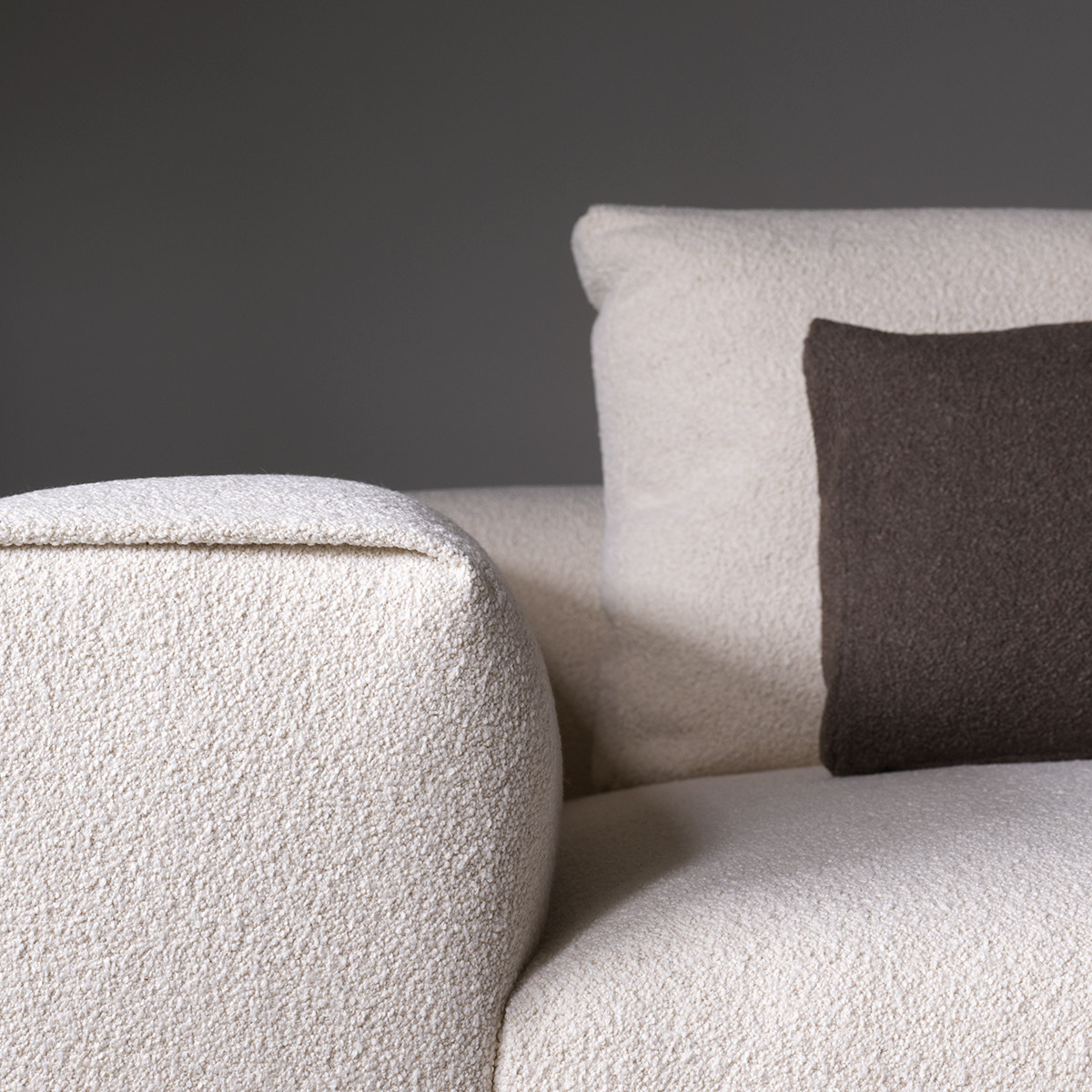 Arm detail of Raft sofa in cream bouclé fabric by Wendelbo