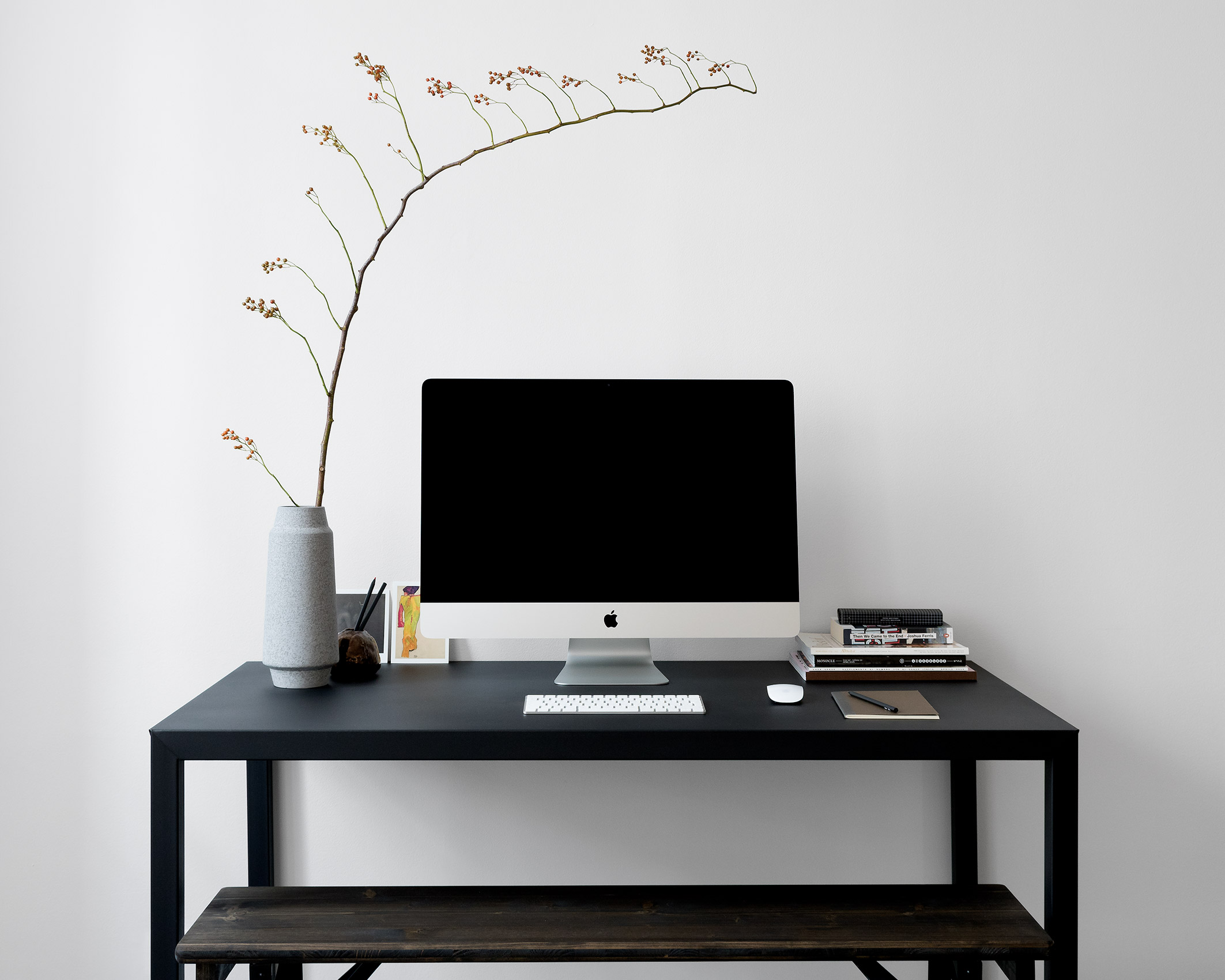 Black metal desk and bench with iMAC and Japanese concrete vase