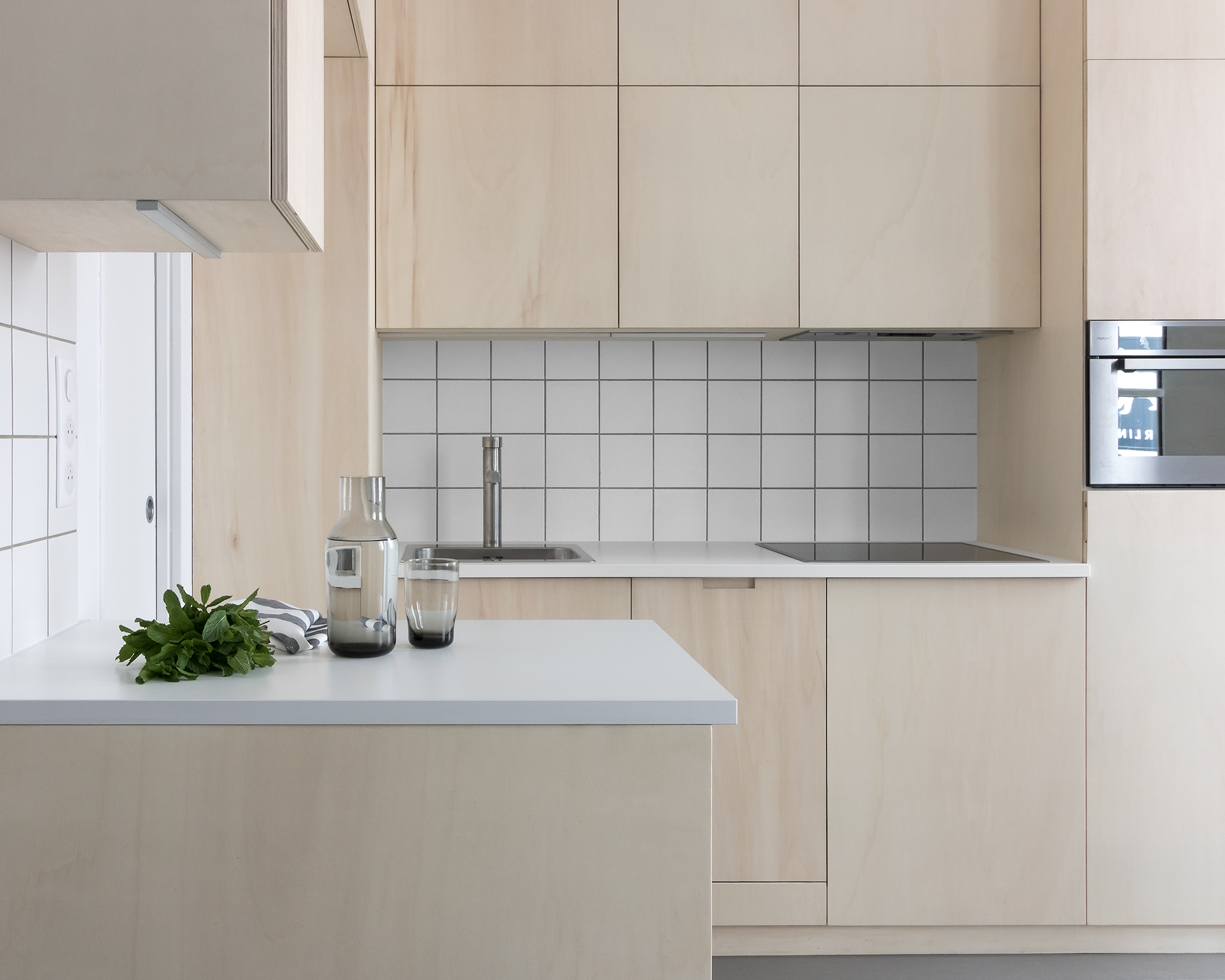 Japanese style, minimal, modern plywood kitchen with grey oak floor and white tiles