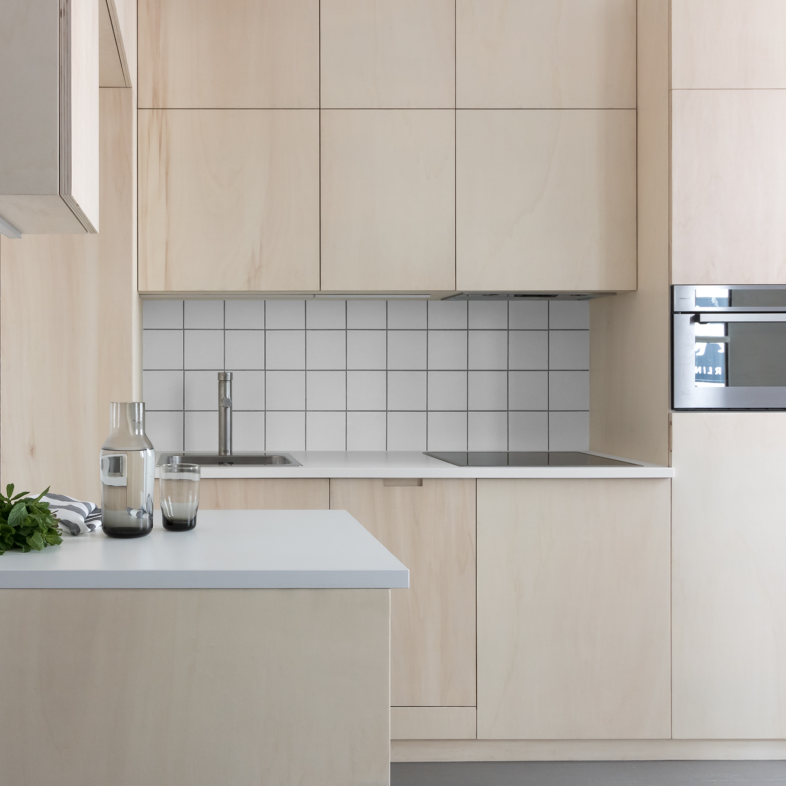 Japanese style, minimal, modern, open-plan, plywood kitchen with grey floor and white tiles