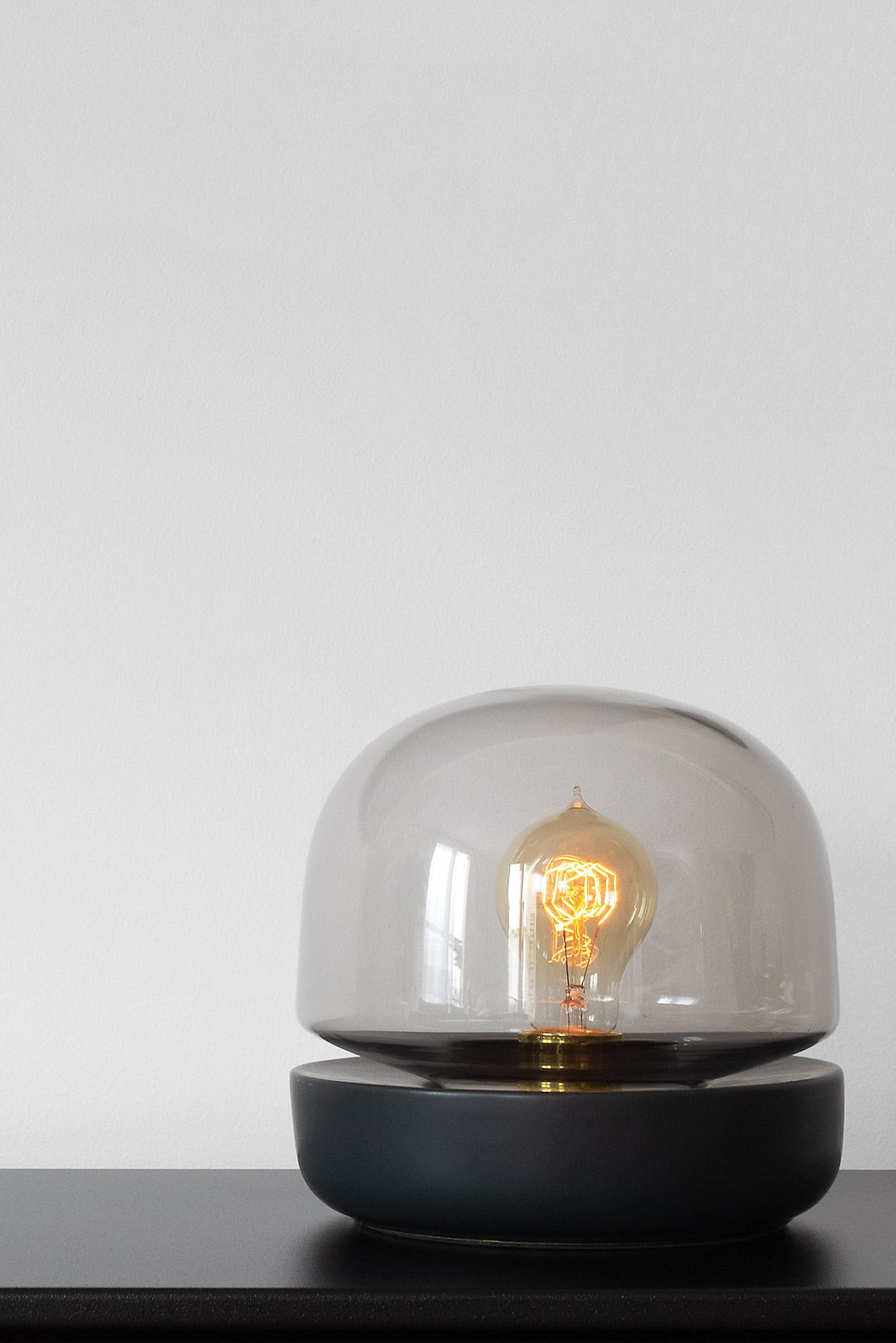 Black metal cabinet with a modern glass dome table lamp