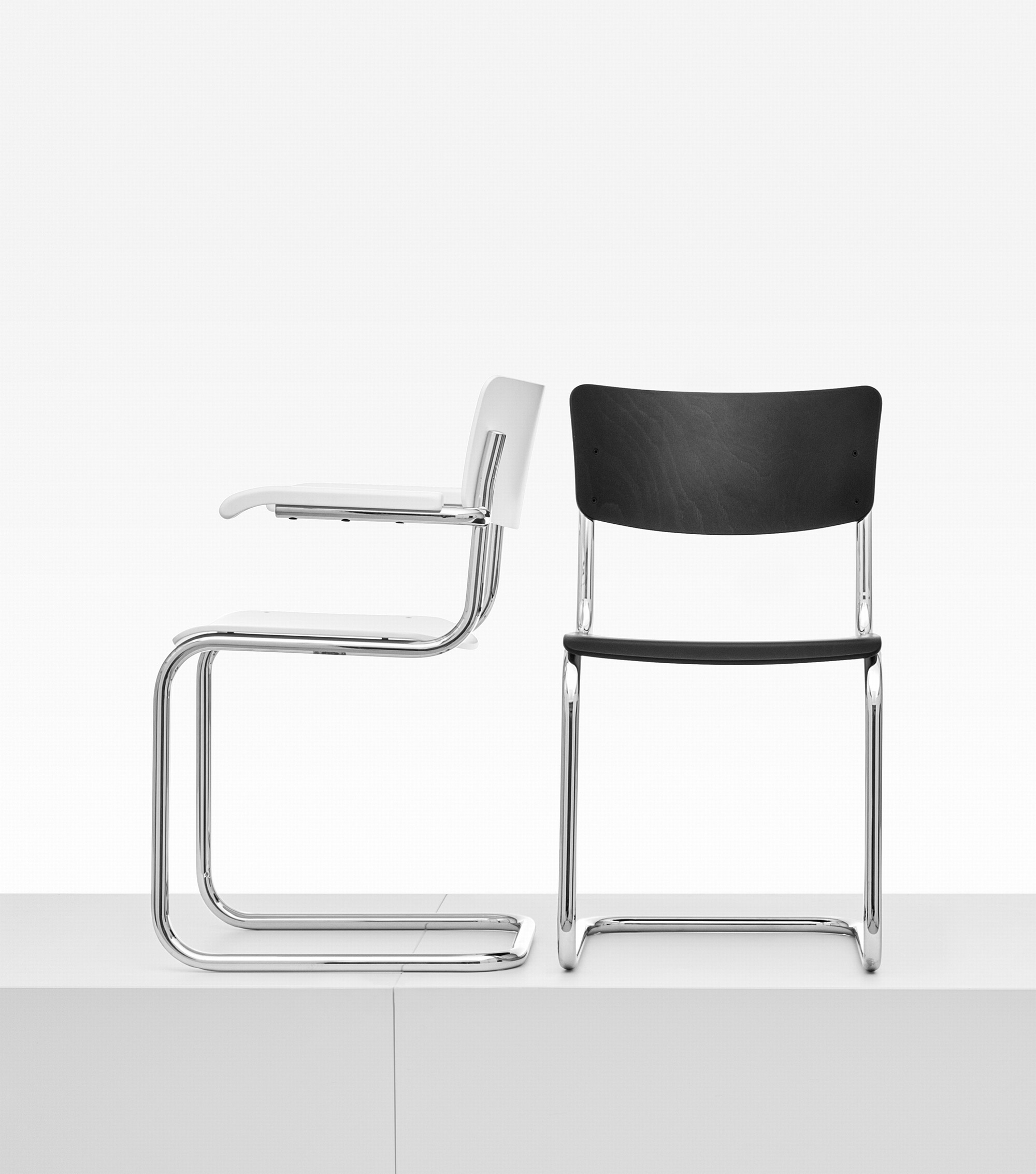 Iconic Bauhaus S 43 cantilever chair in chrome steel, black or white plywood seats