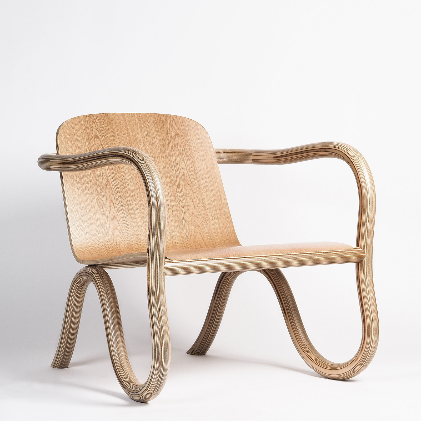 Moulded oak plywood lounge chair