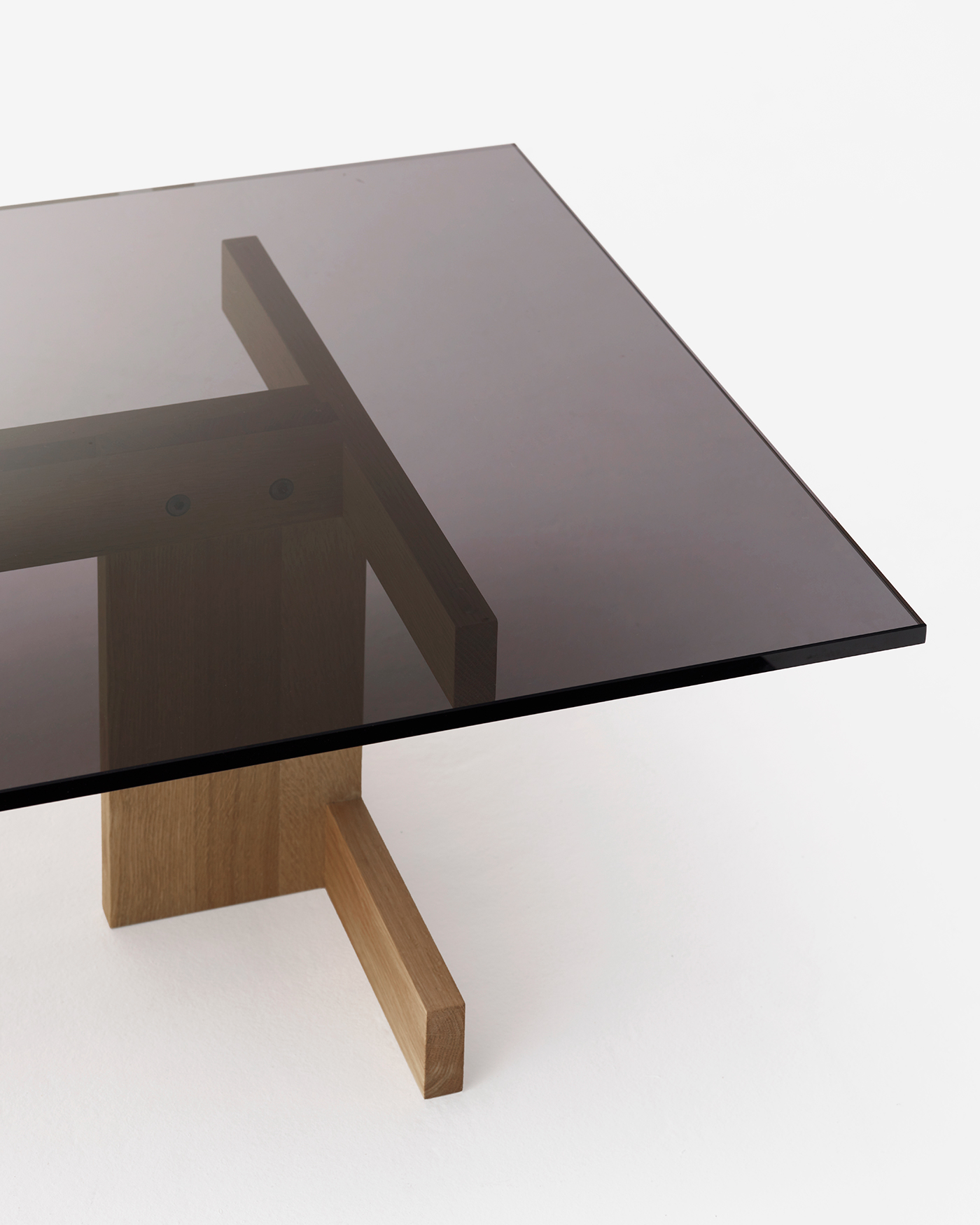Smoked glass table top on solid geometric oak legs