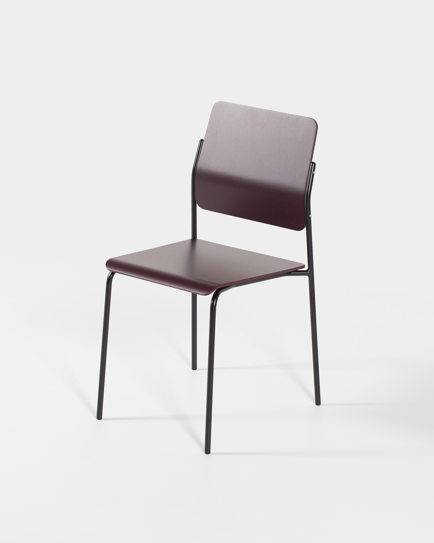 Burgundy plywood and black tubular steel stackable chair