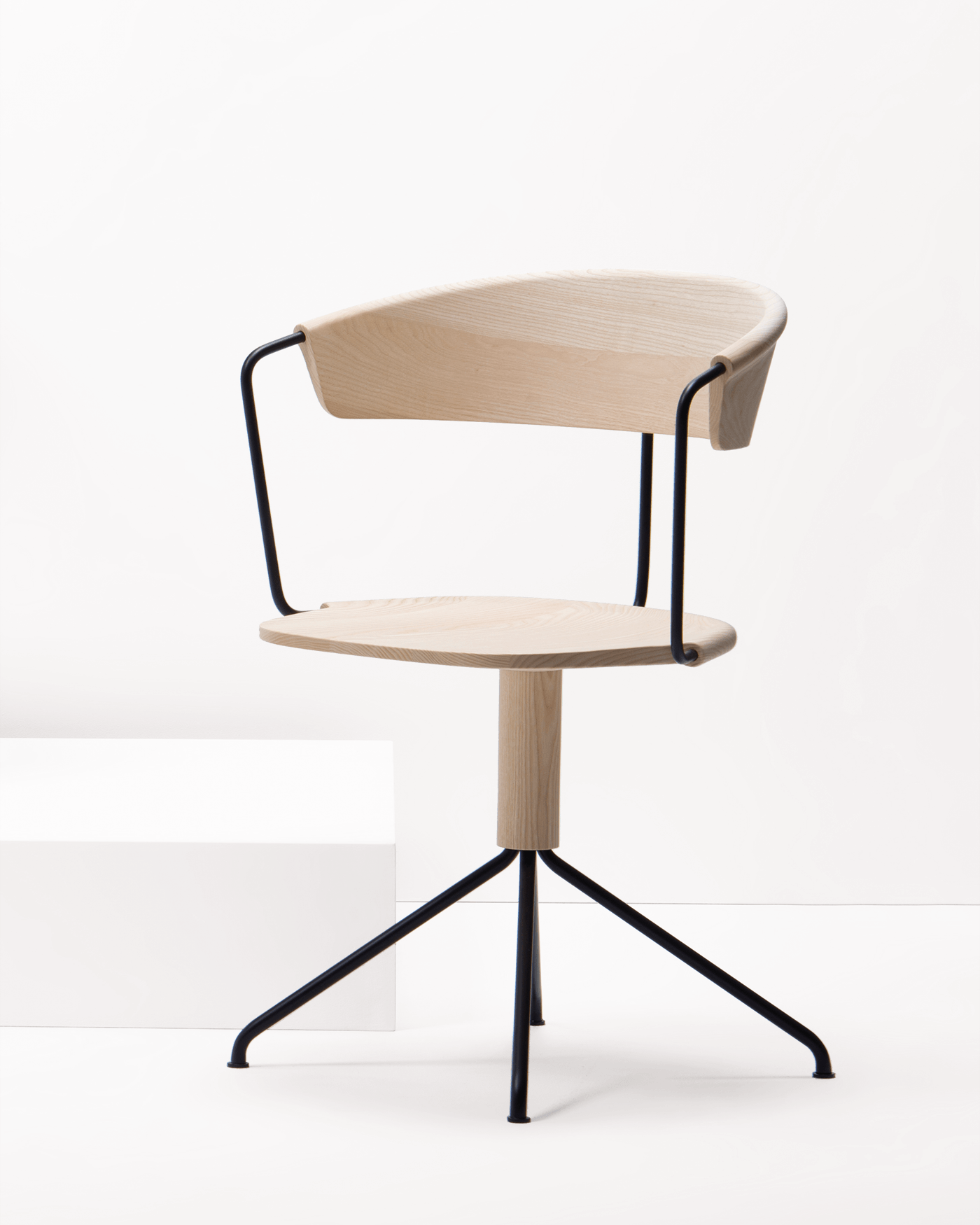 modern swivel chair in ash wood and black tubular steel