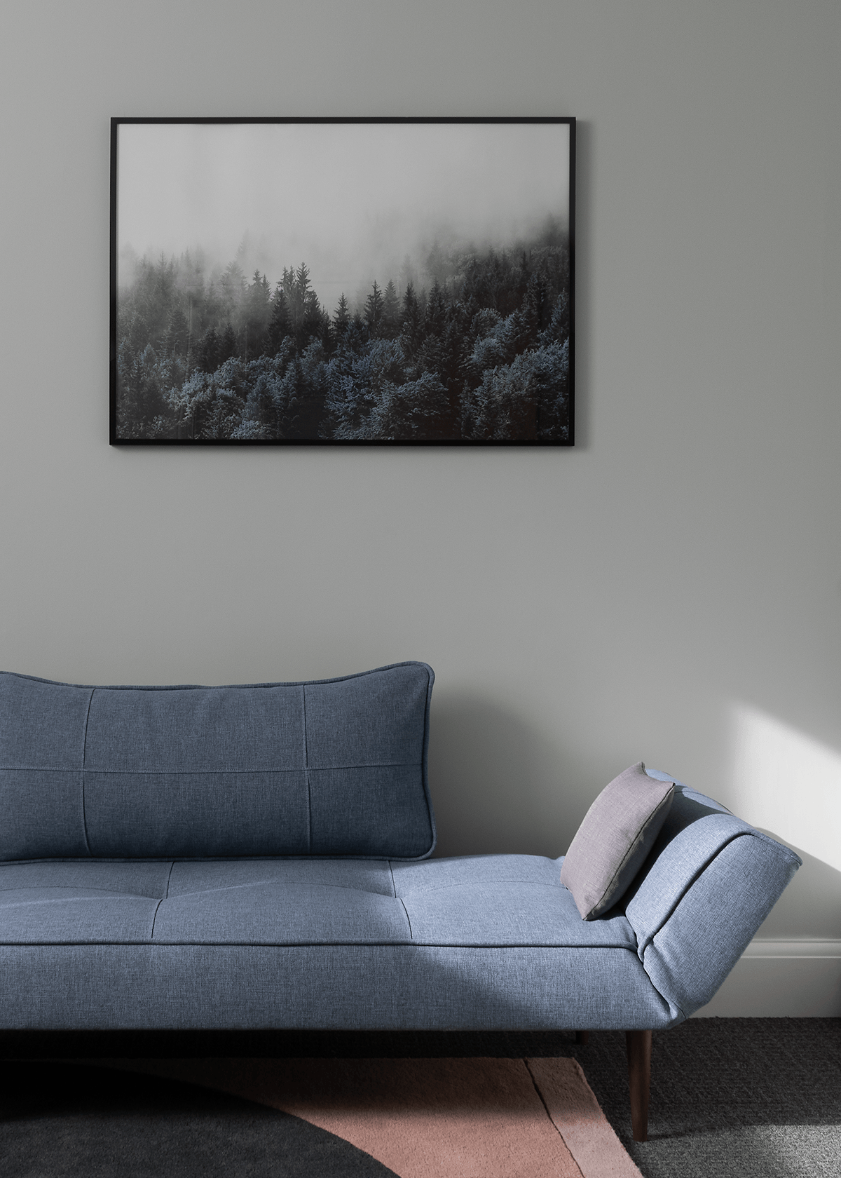 Grey blue daybed on pink and charcoal abstract rug, Scandinavian forest artwork