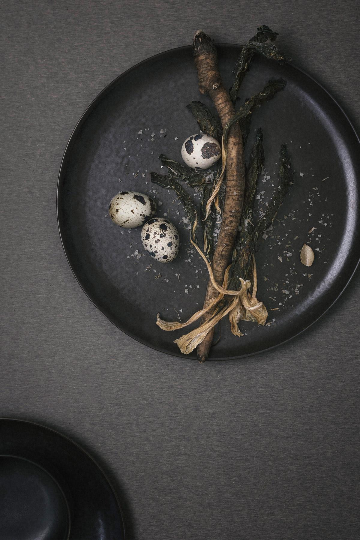 Dark glazed dinner plate with quails egg