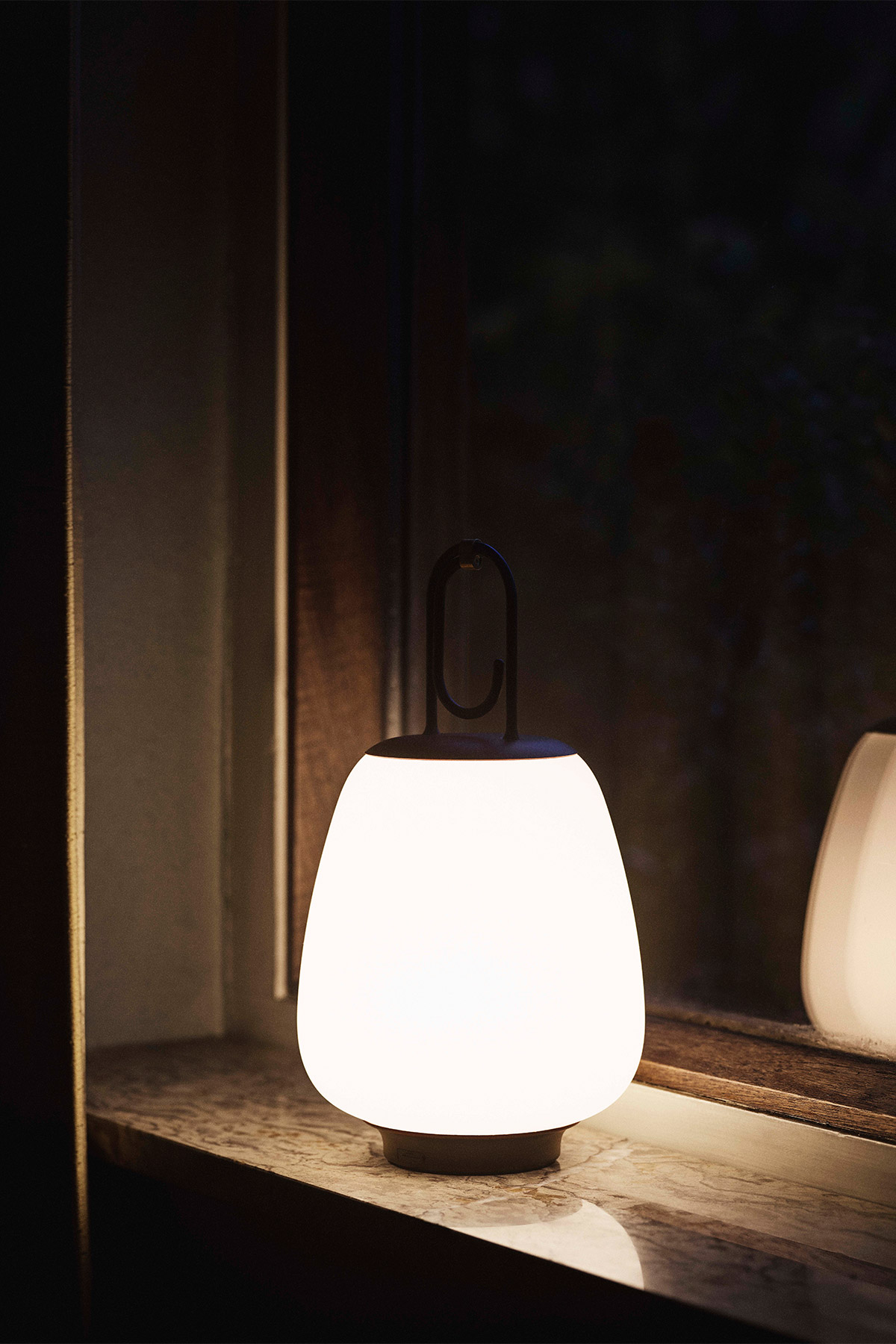 Lucca side lamp by &Tradition on windowsill