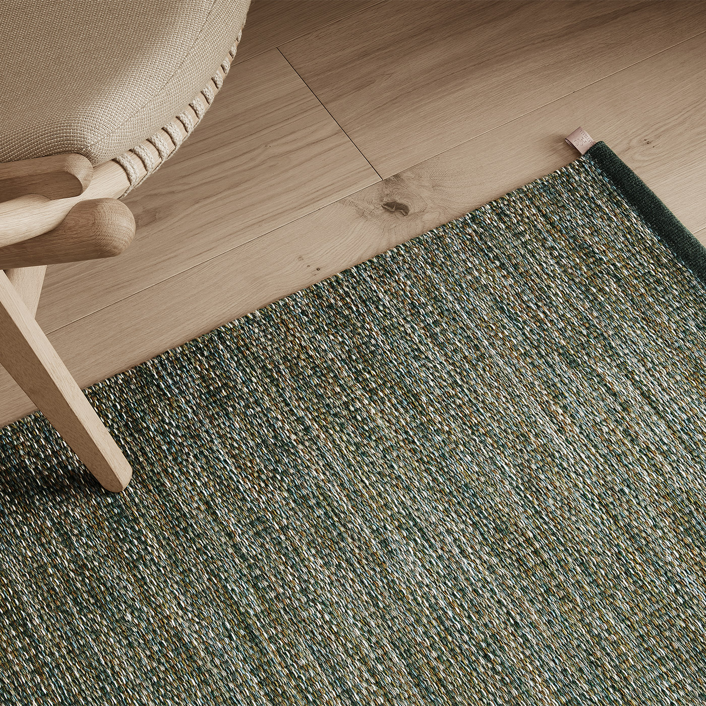 modern green marl rug with Scandinavian light oak armchair