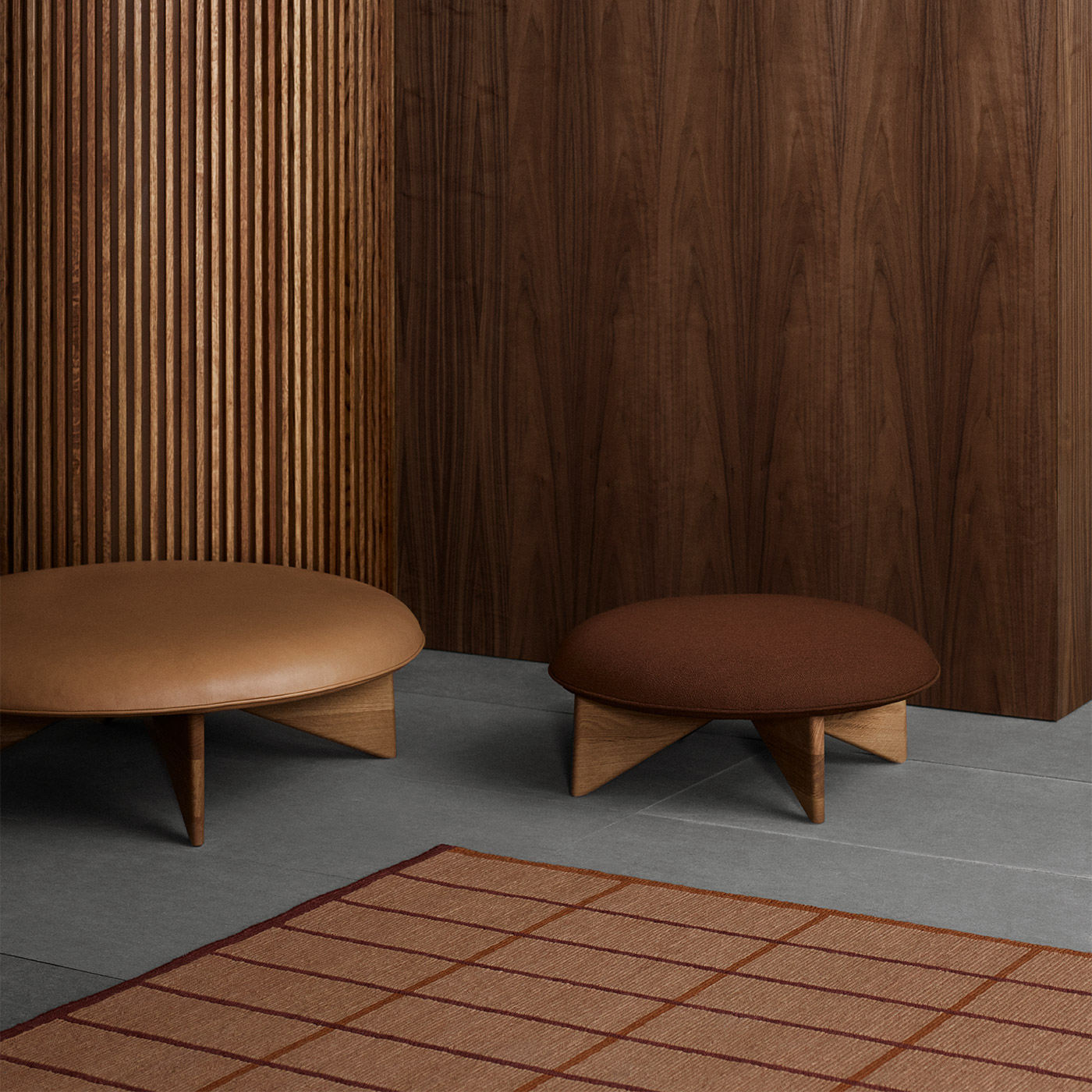 tan geometric wool rug with modern Scandinavian dark wooden stools