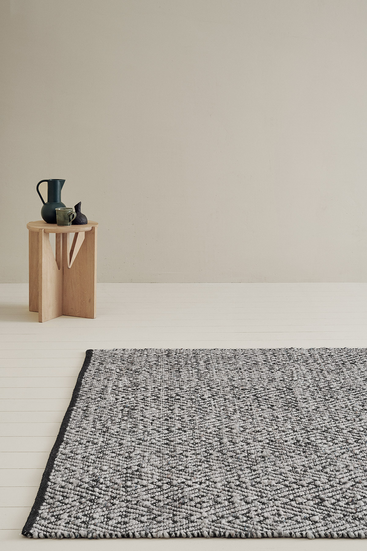 black and white geometric rug in minimal room