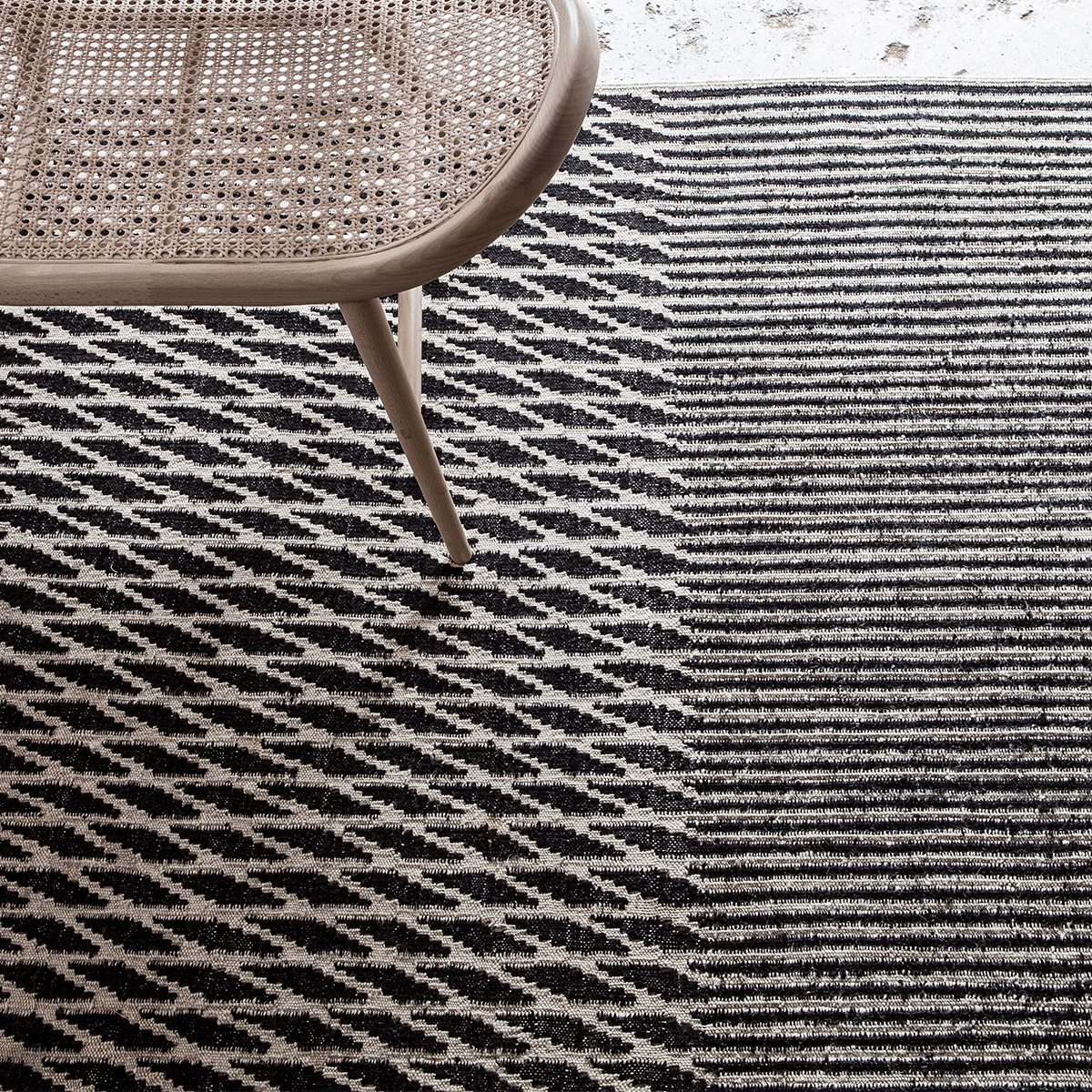 black and white geometric rug with Japanese light oak chair
