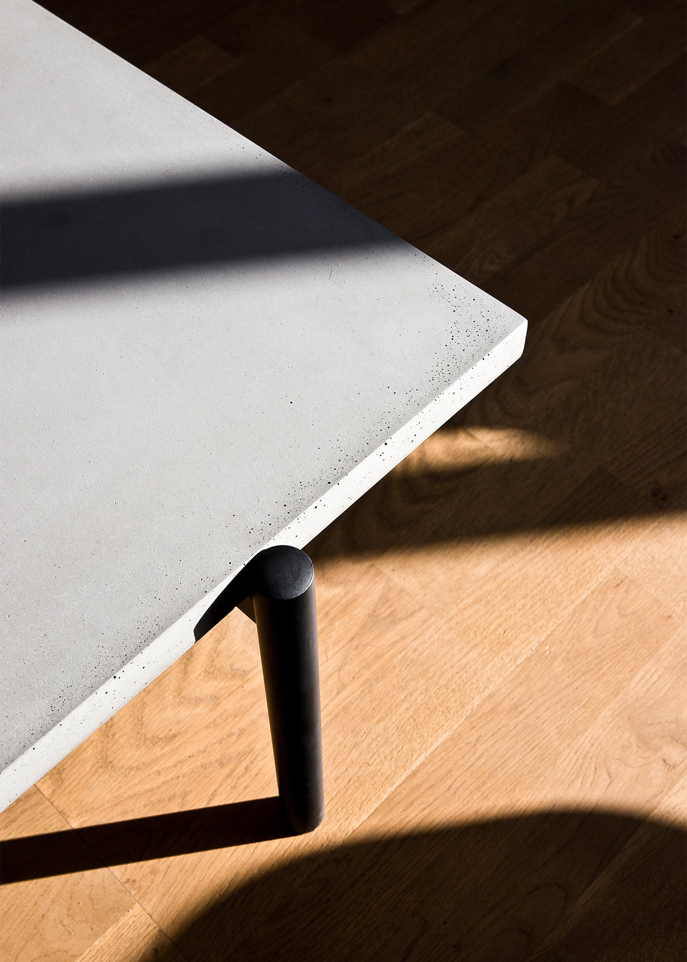 concrete and black metal coffee table in sunlight