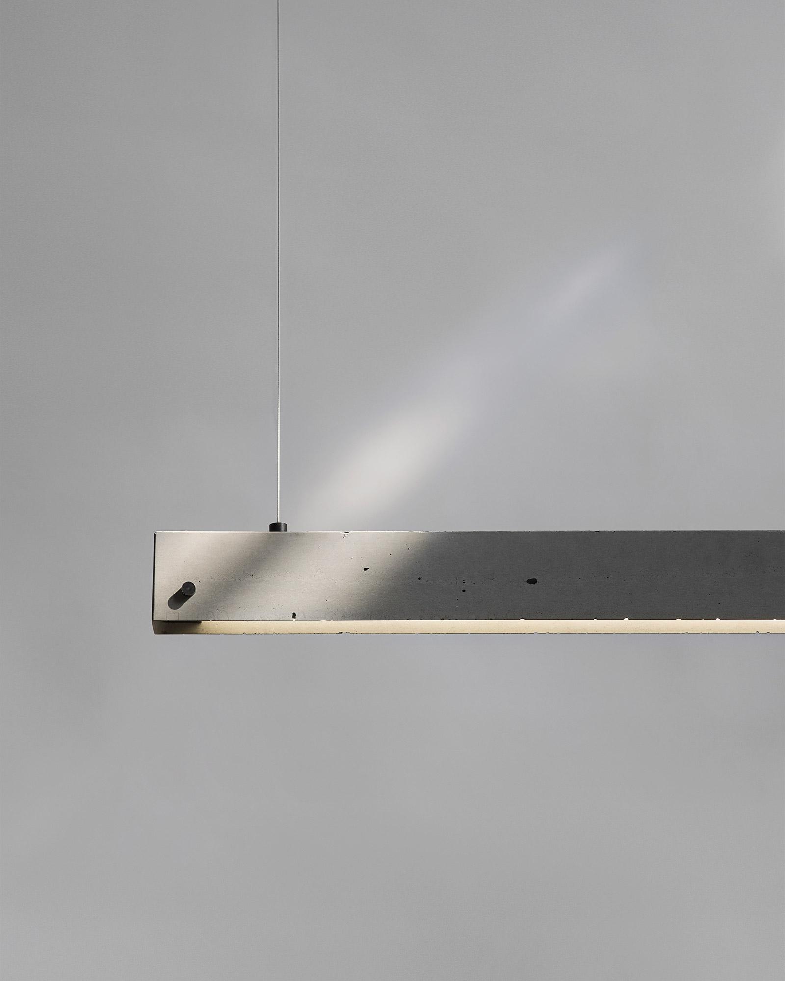 concrete pendant strip light on fine wires