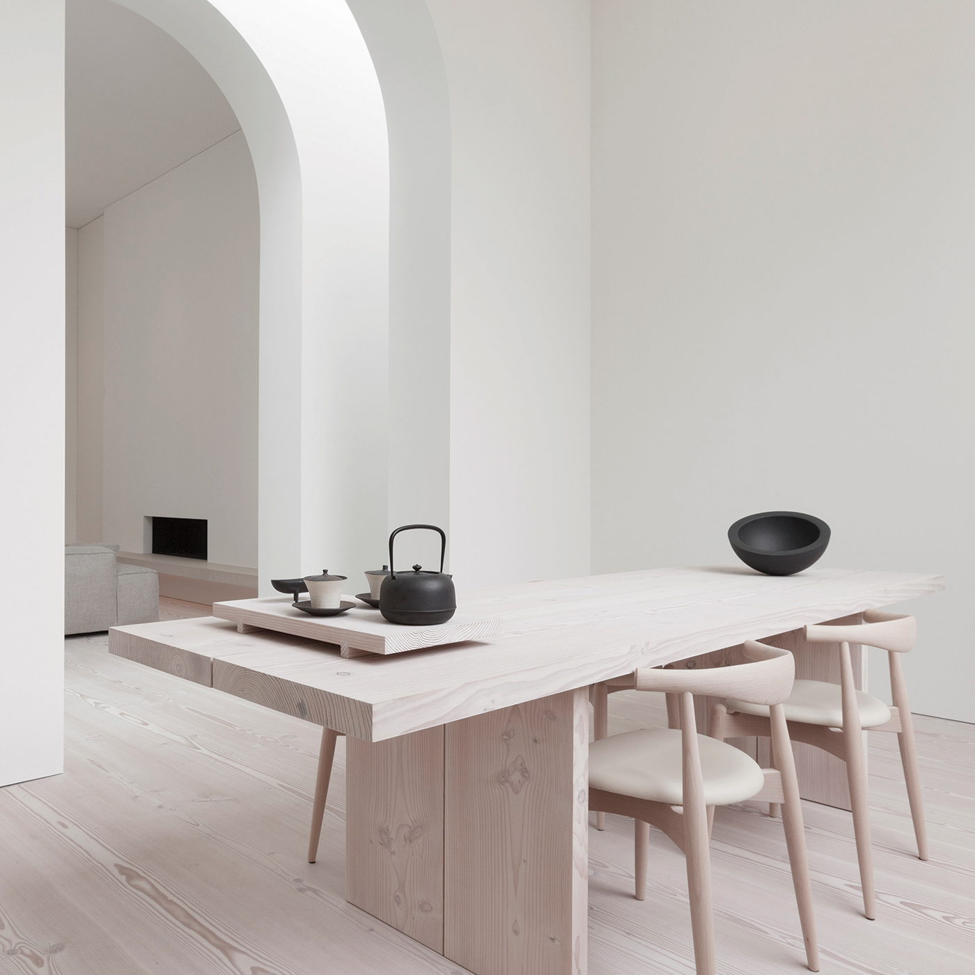 minimal wooden dining table in a calm white Japanese interior with wooden Douglas floor