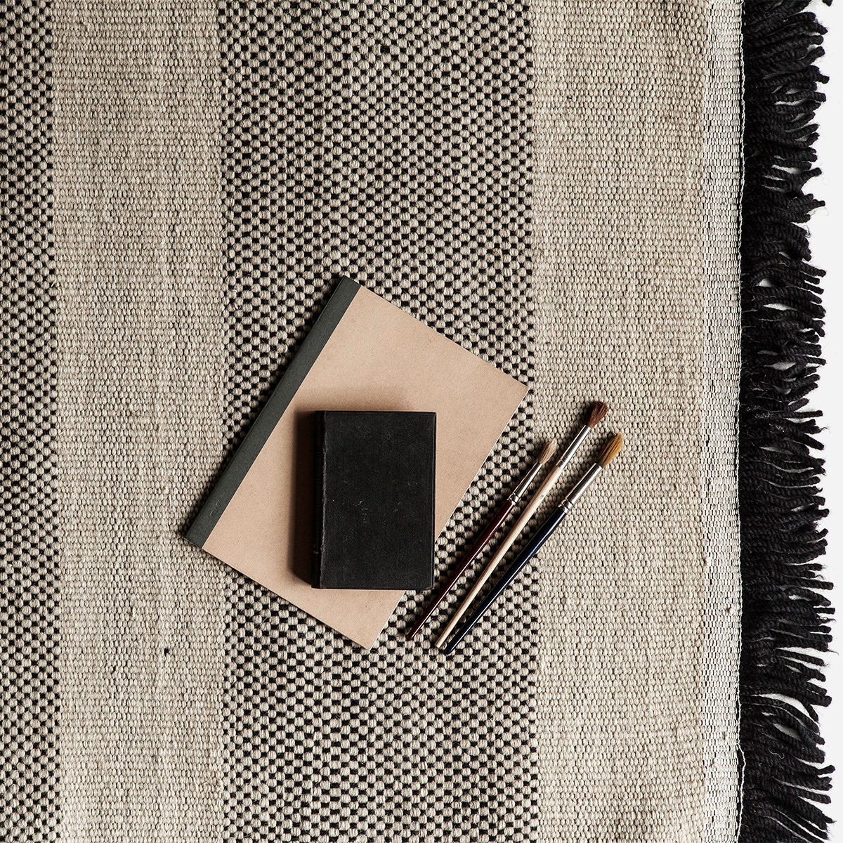 flat hand woven Dhurrie rug in natural and black