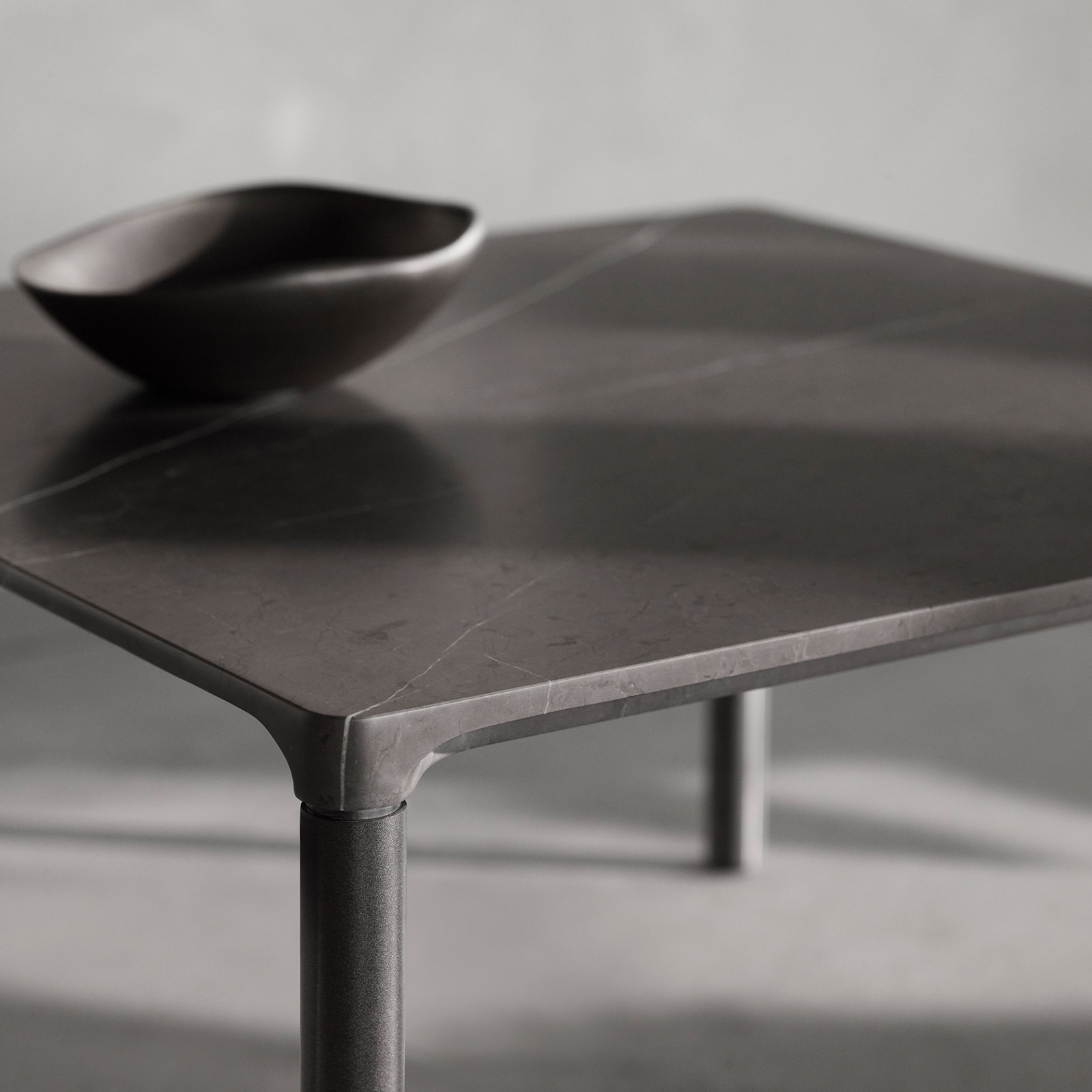 grey marble coffee table and bowl with sunlight and shadows