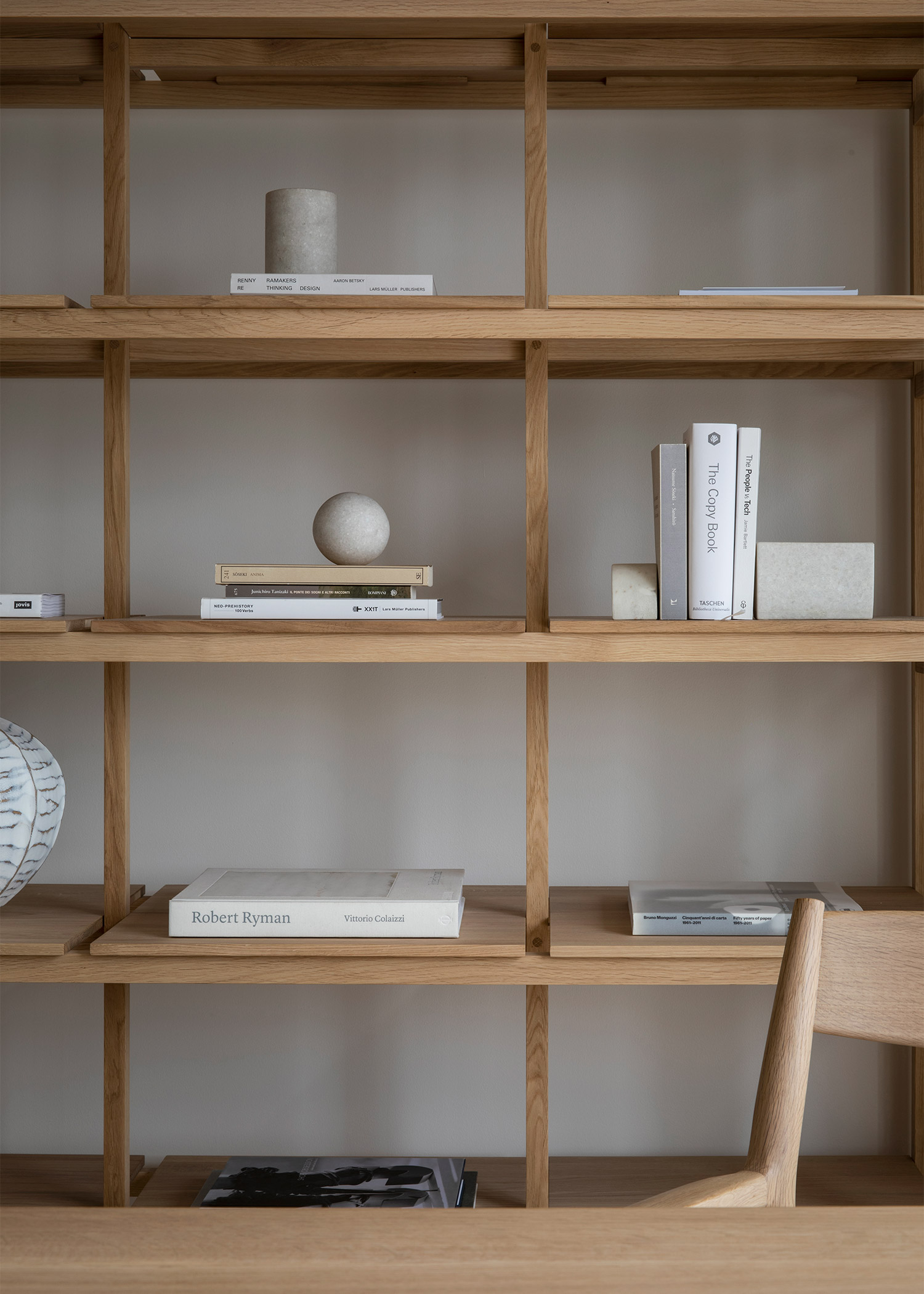 minimal solid oak shelving in a calm home