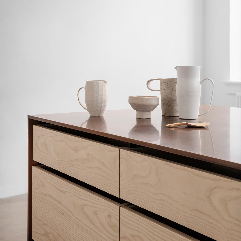 Framed kitchen by Garde Hvalsøe with detail of copper worktop and ash wood drawers