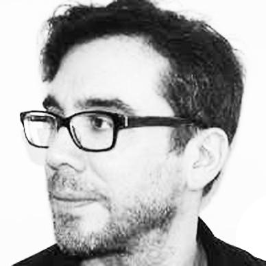 Black and white portrait of Guy Baumann