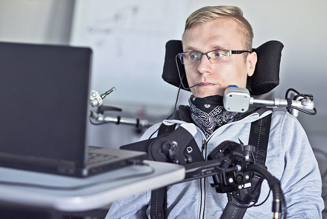 disabled man using assistive technology to navigate websites