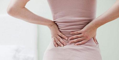 Dấu hiệu mang thai dễ nhận biết là đau lưng