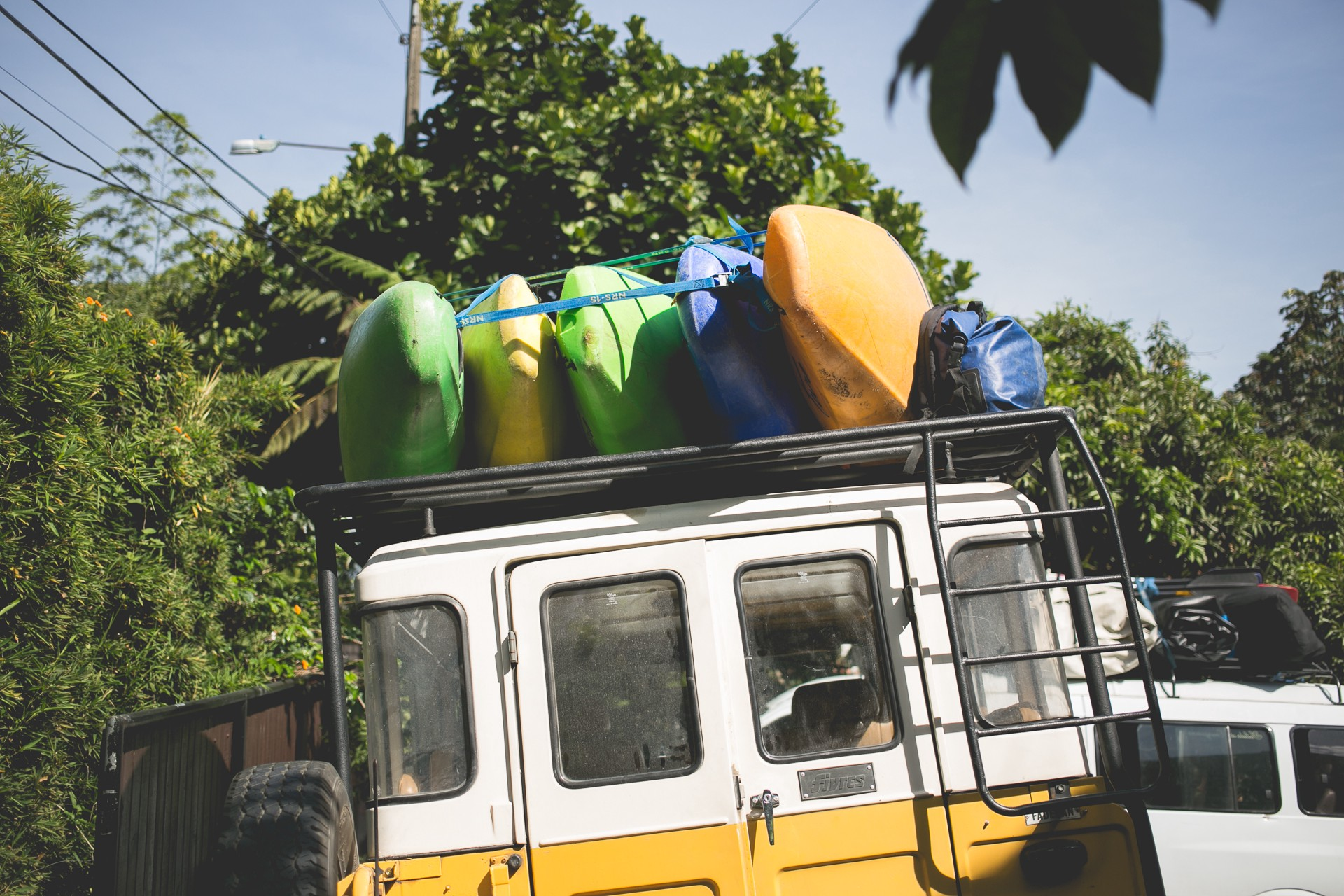 Kayaks and gear loaded on a yellow jeep in Medellin